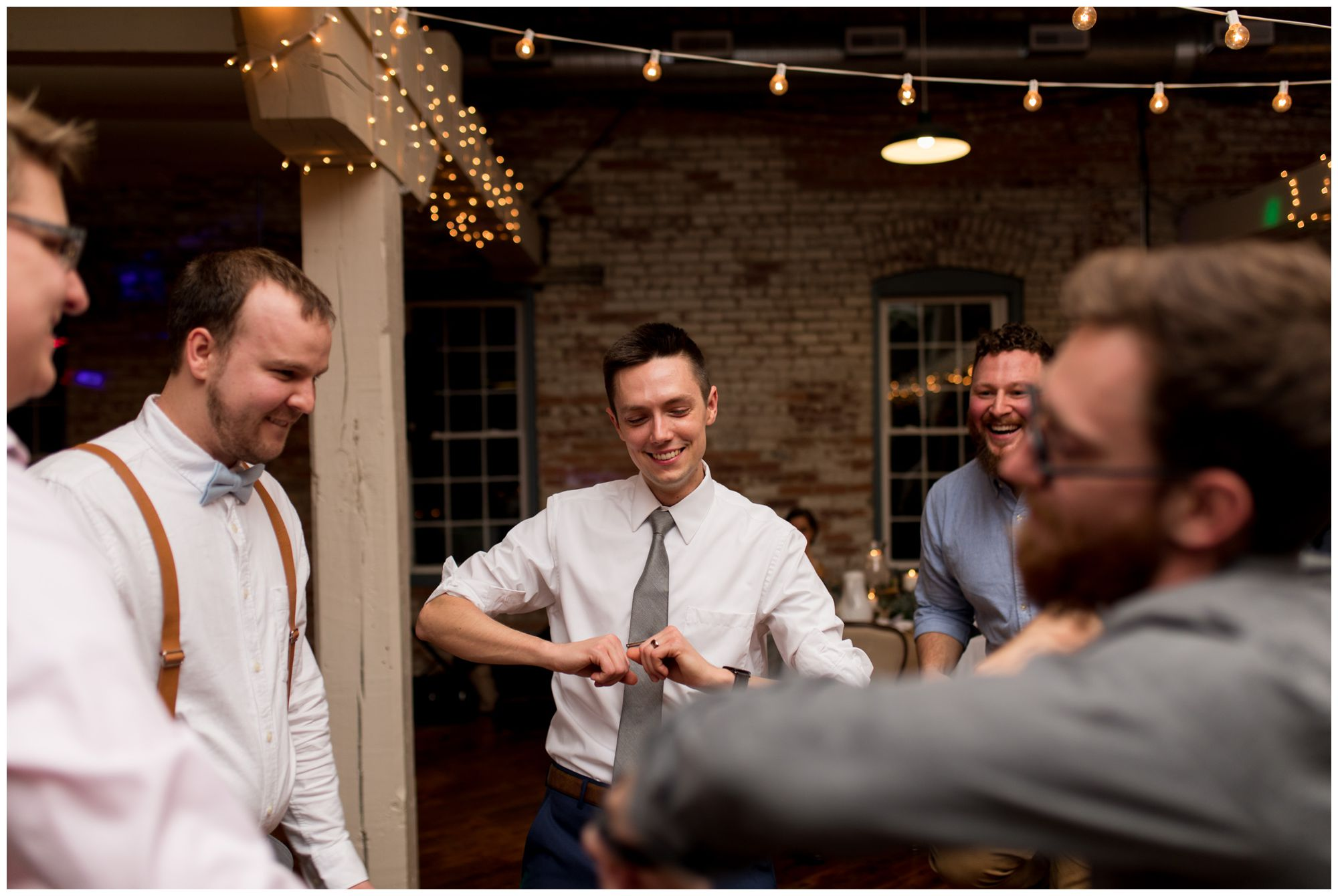 groom dances at Bread & Chocolate wedding reception