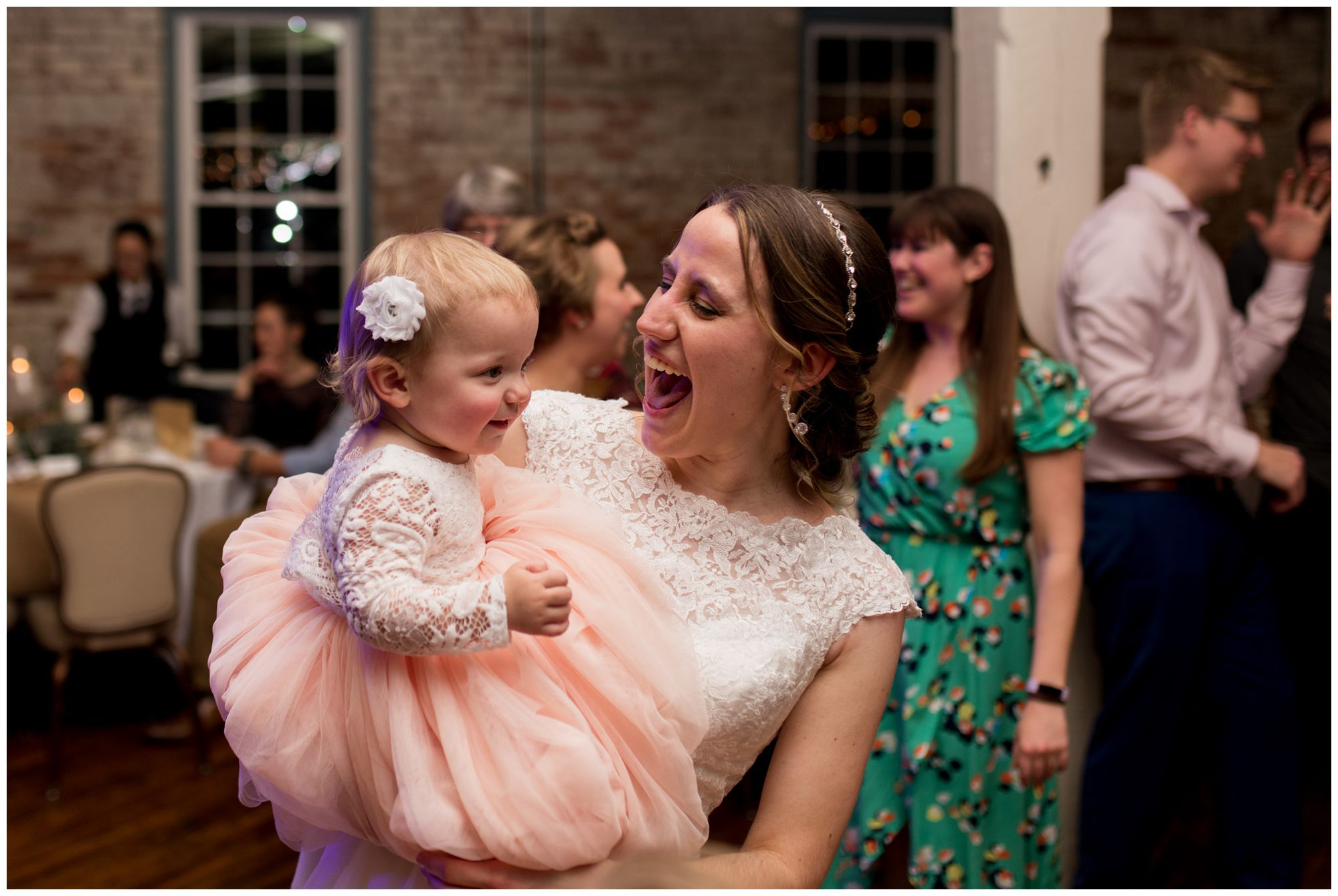 bride dances with flower girl at Bread & Chocolate wedding reception
