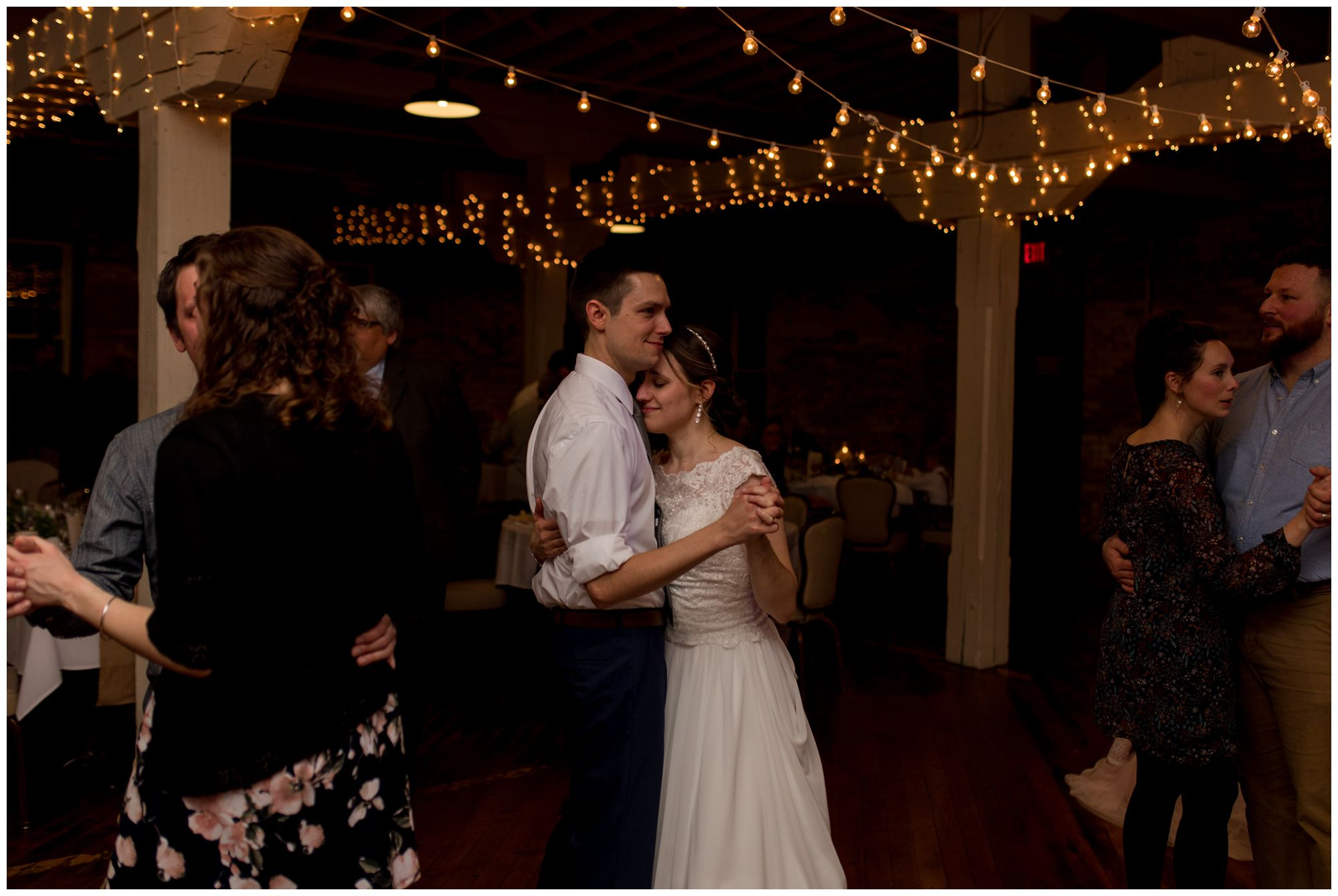 bride and groom dance together at Bread & Chocolate wedding reception