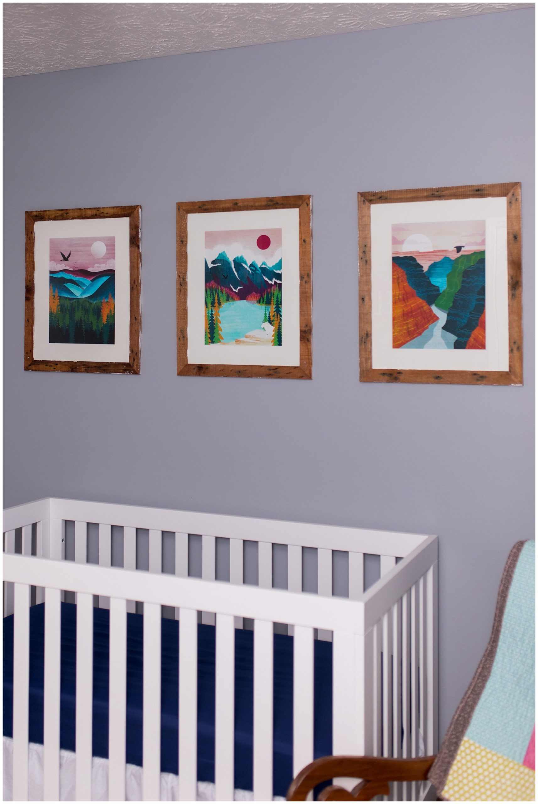 baby nursery with artwork of United States national parks