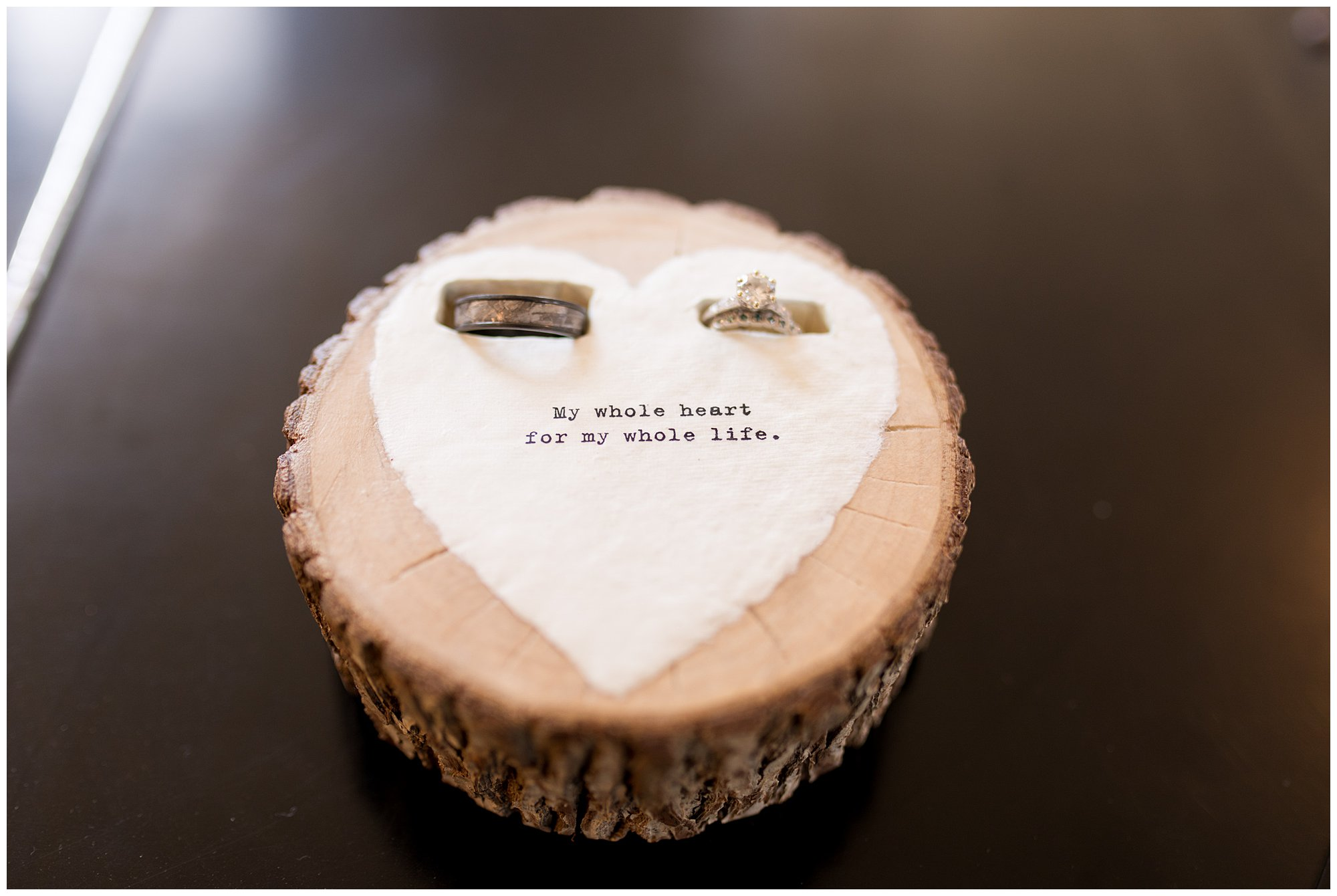 wooden ring holder that says my whole heart for my whole life with rings inside