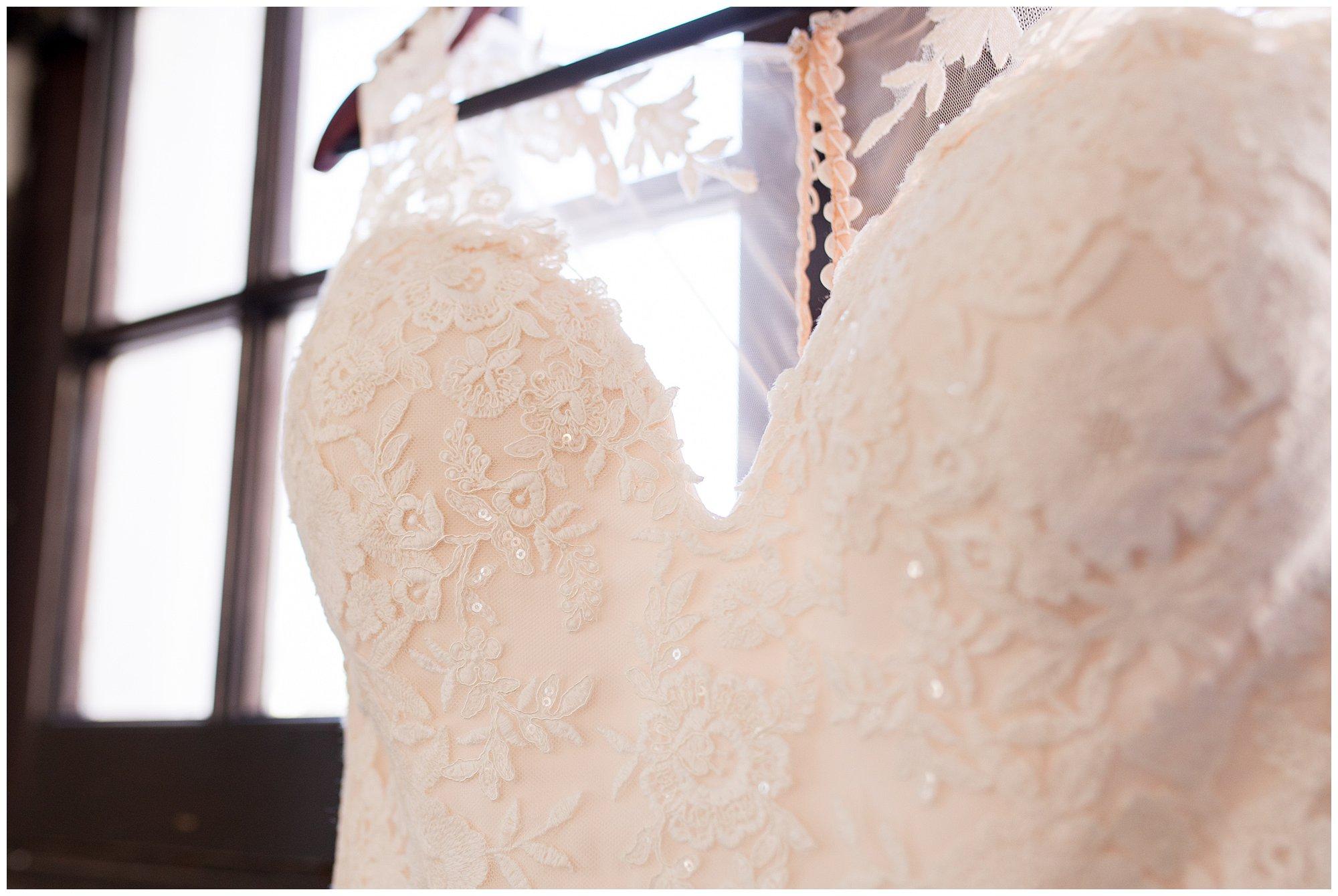 closeup of bride's wedding dress in window