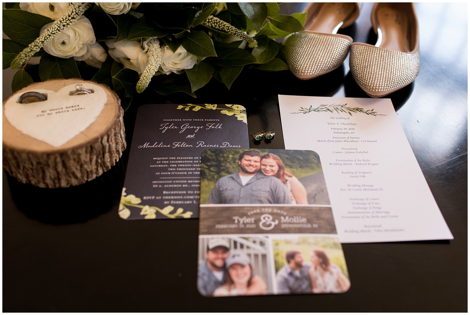 wedding invitation suite with bride and groom rings and bridal bouquet at Indianapolis wedding