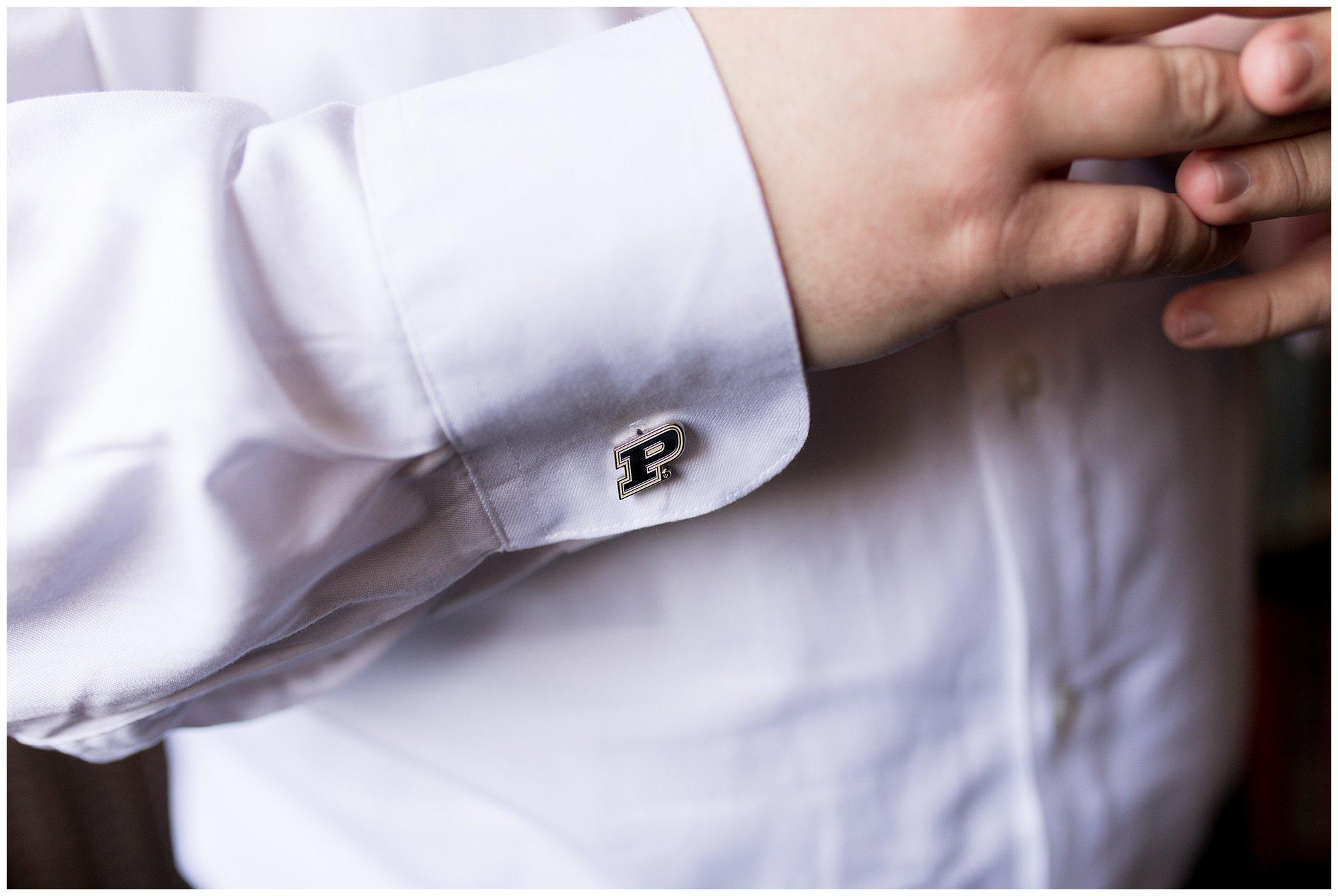 closeup of groom's Purdue University cufflinks