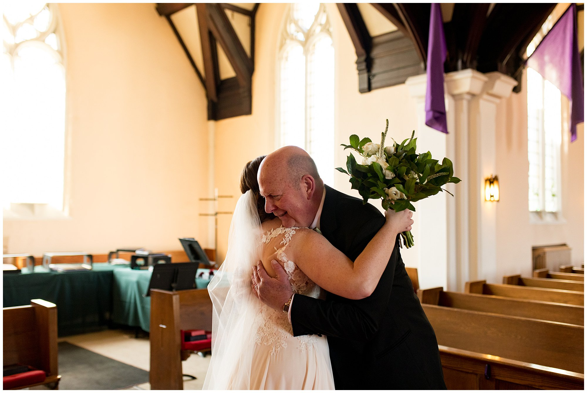bride's father hugs bride before wedding ceremony at Irvington United Methodist Church in Indianapolis
