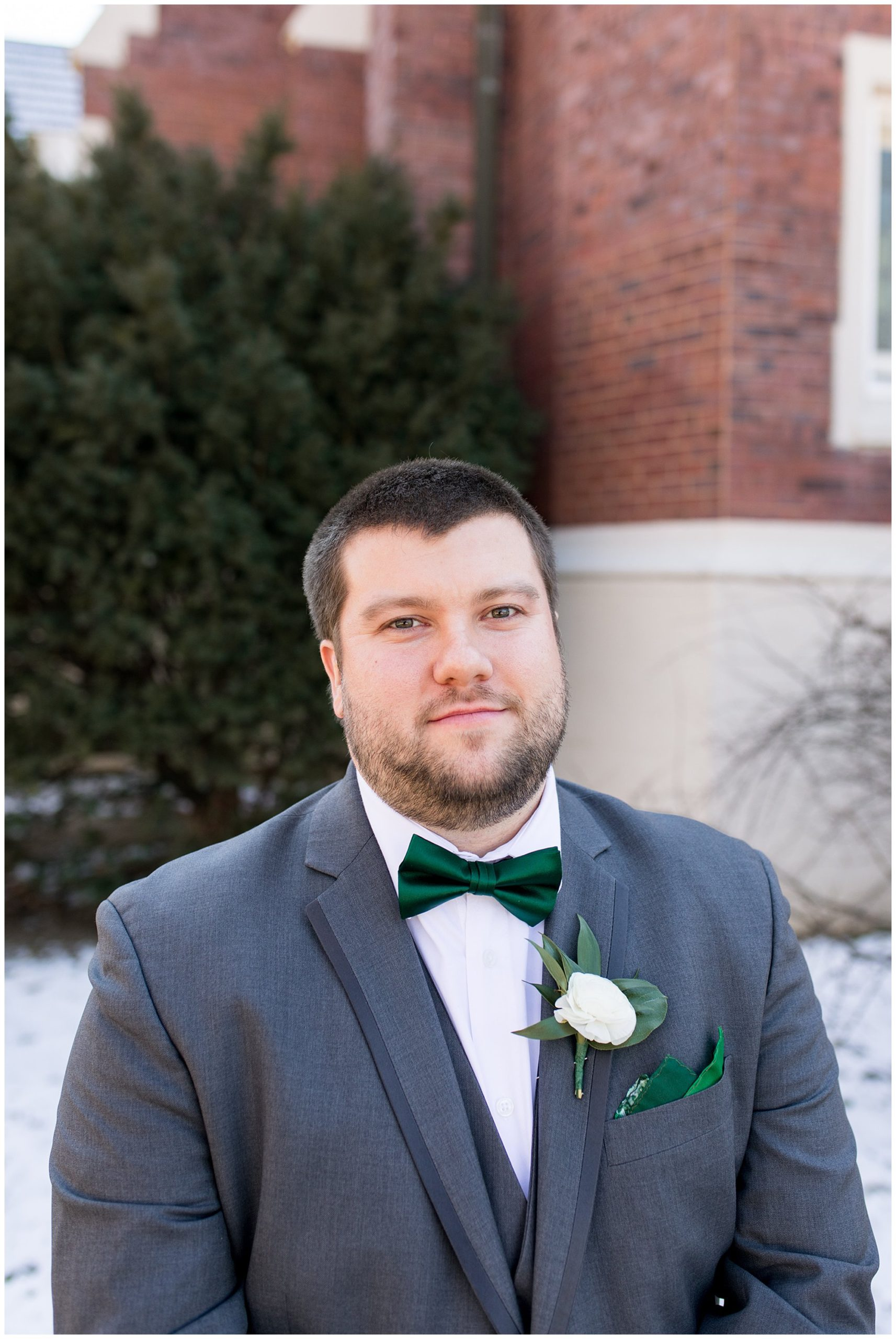 groom wearing bowtie outside church in Indianapolis