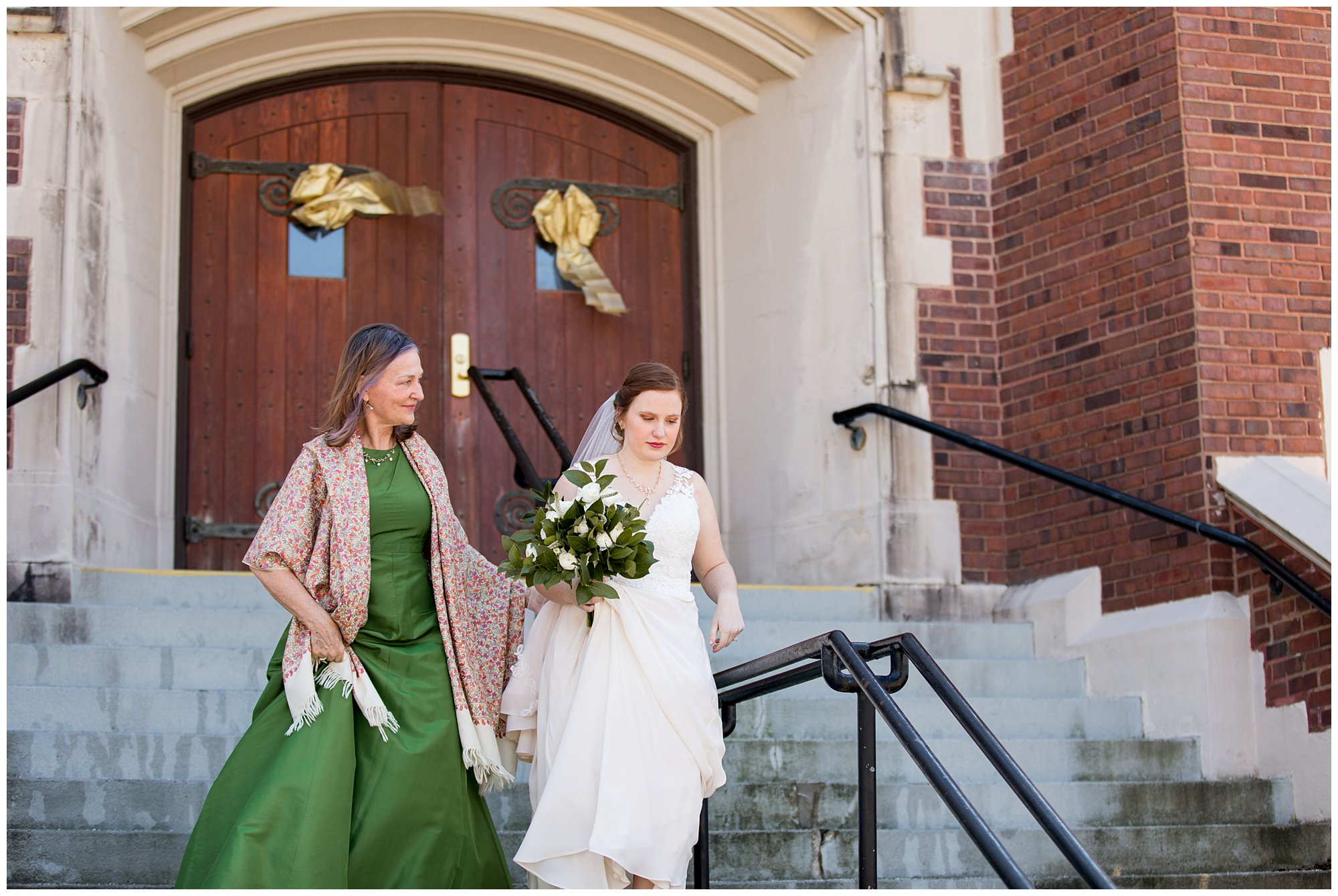 bride's mother walks bride toward groom for first look before wedding ceremony