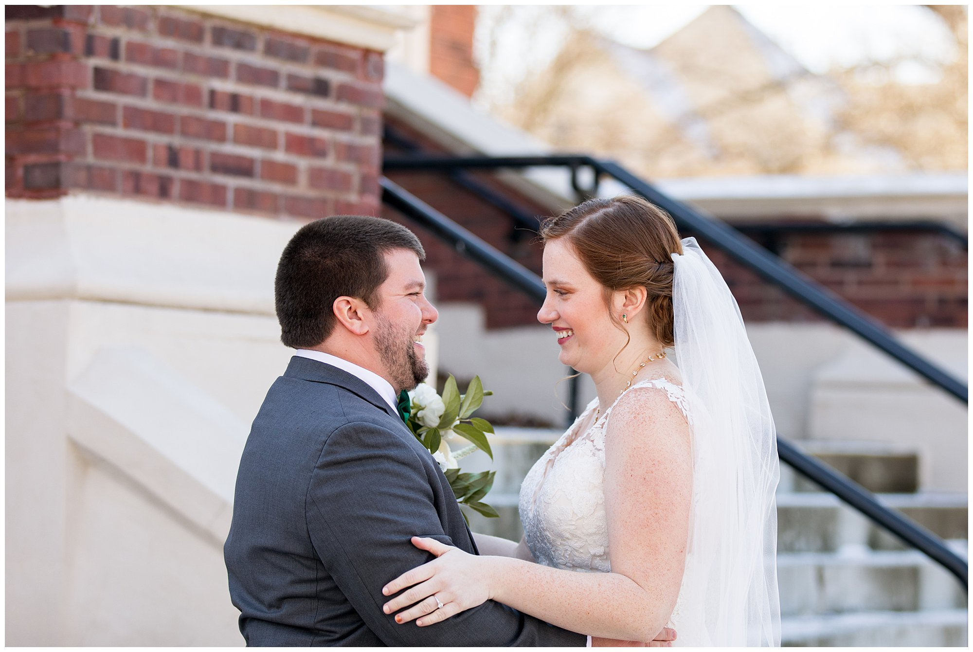 bride and groom smile at each other during first look before Indianapolis wedding ceremony
