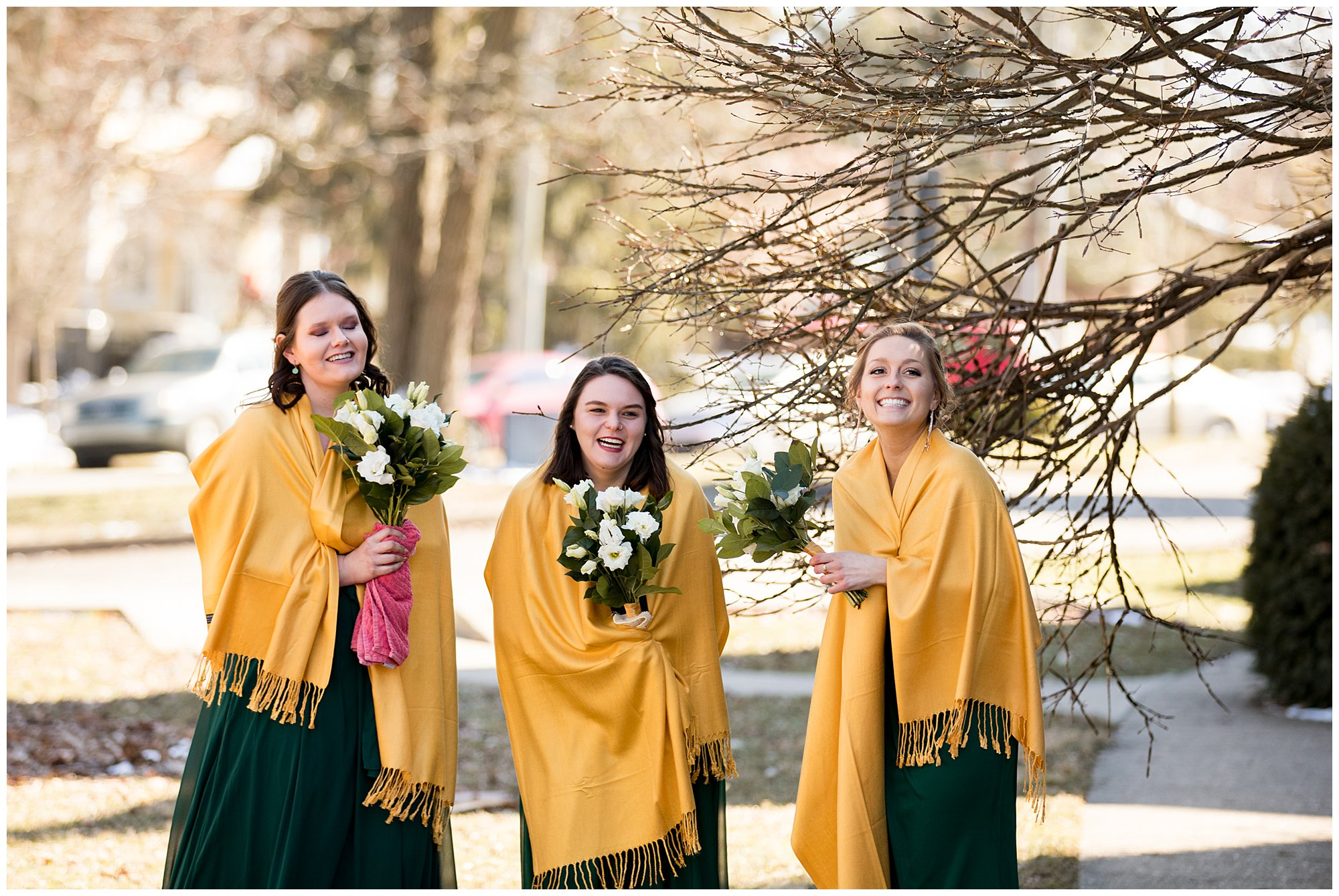 bridesmaids watch bride and groom have first look in front of church