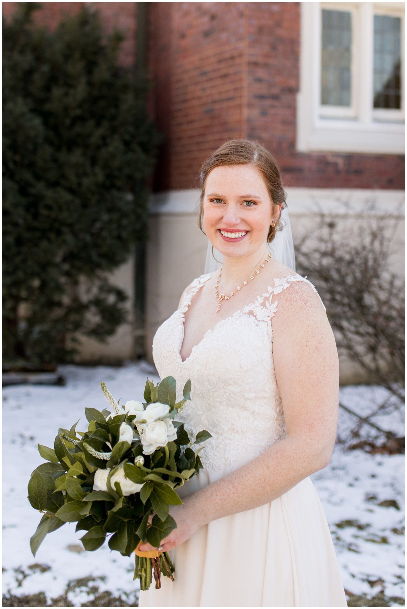 bride standing outside with bouquet from The Flower Boys in downtown Indianapolis