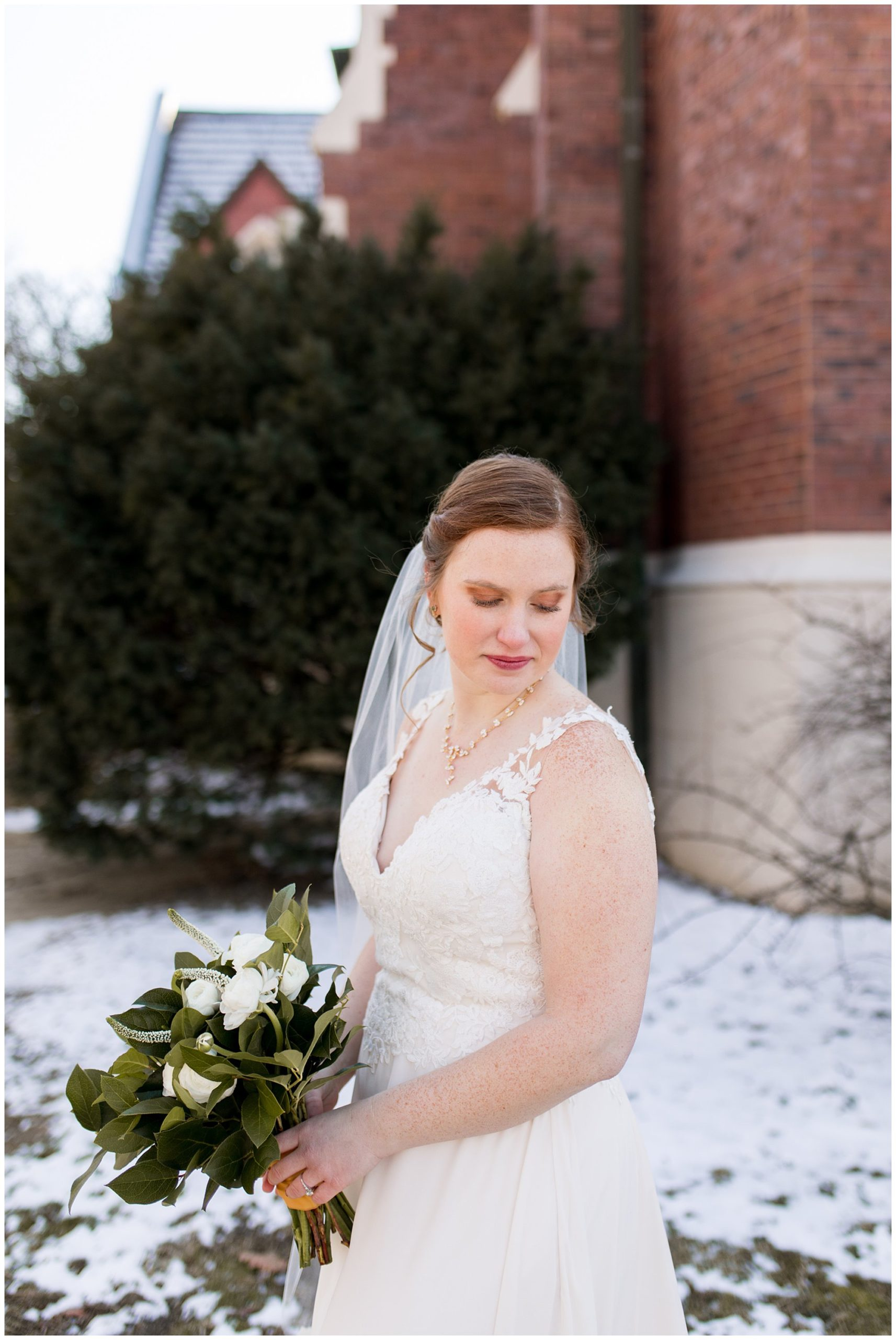 bride looks over shoulder while holding bouquet from The Flower Boys florist in Indianapolis