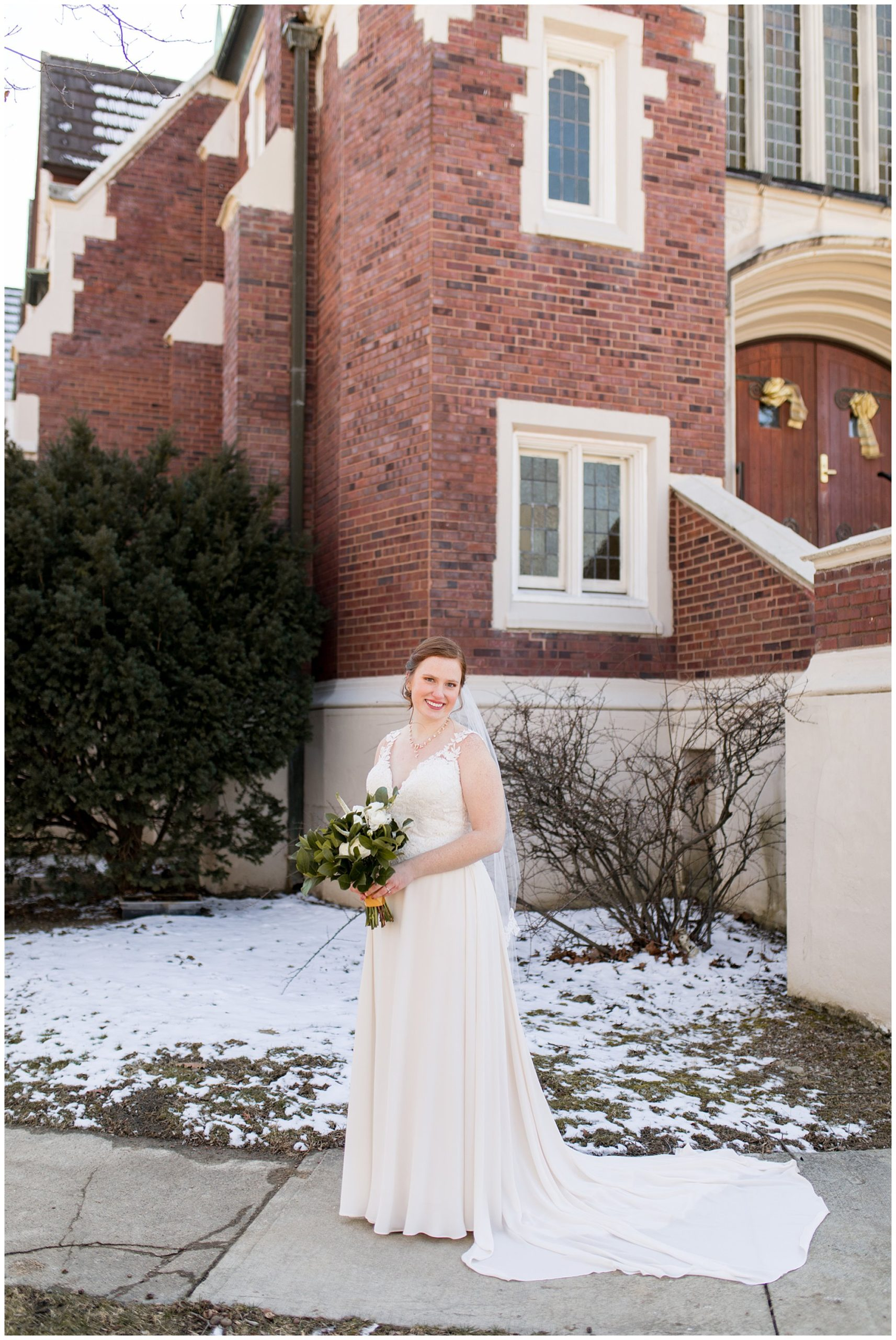 bride holds bouquet from The Flower Boys during wedding portraits in downtown Indianapolis
