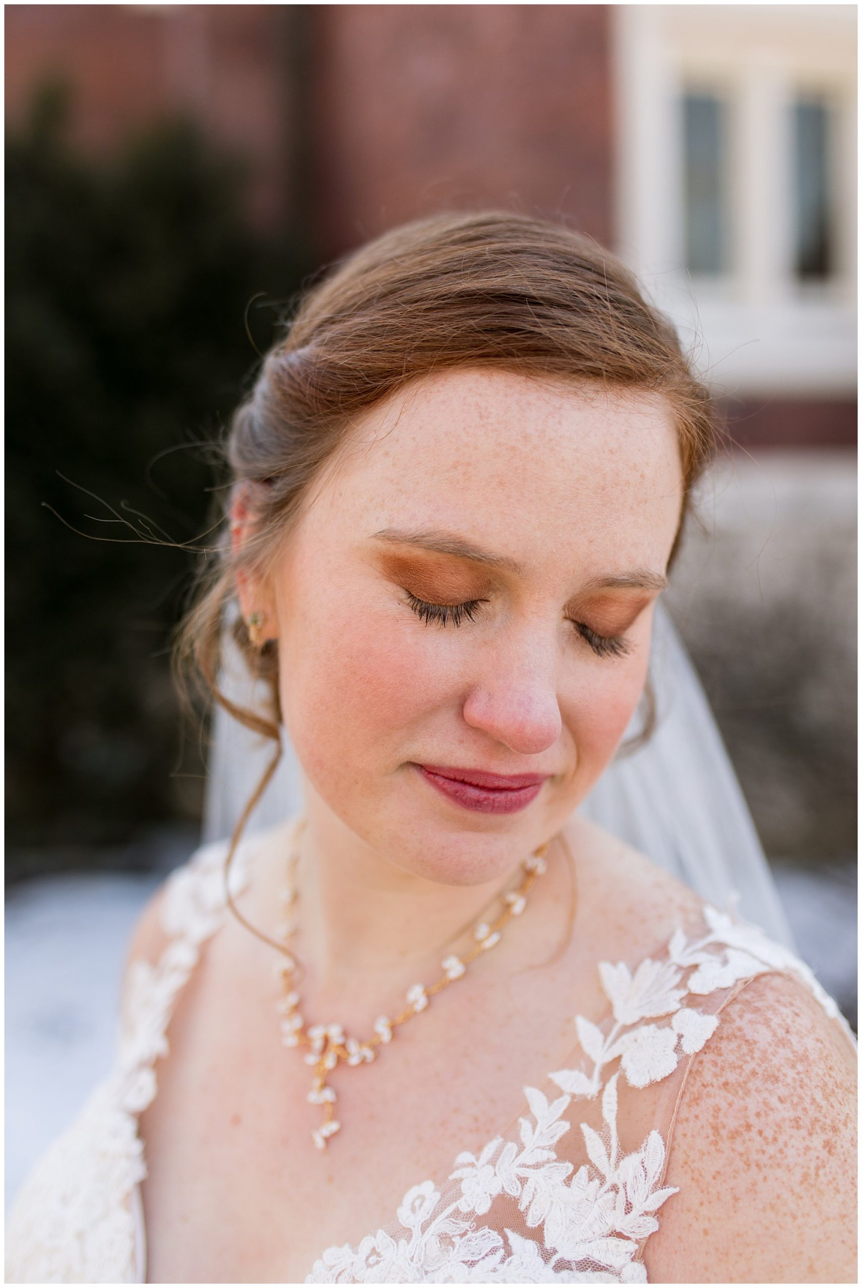 bride looks down over shoulder during wedding couple portraits in Indianapolis