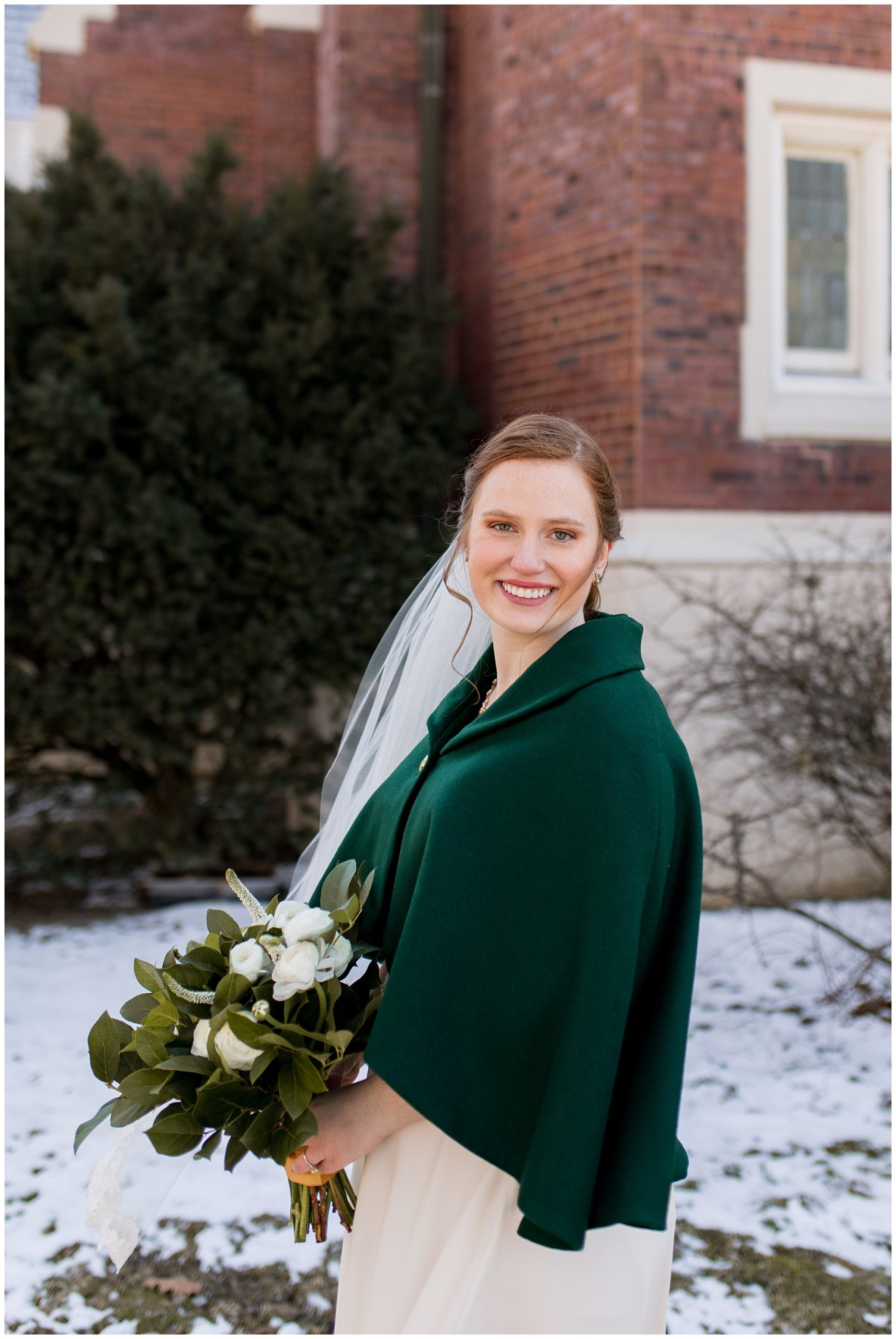 bride with bouquet from The Flower Boys wearing green cape