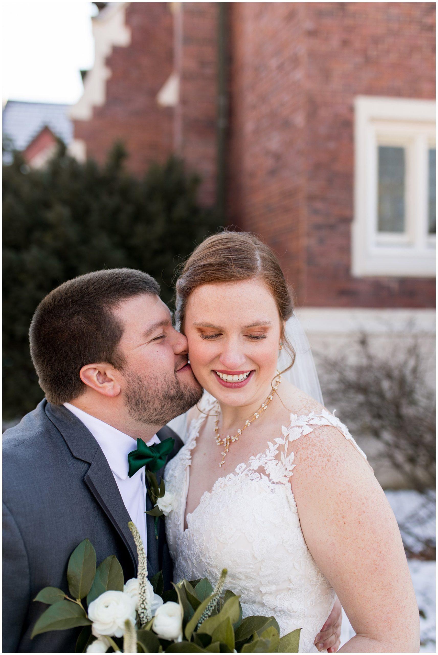 groom nuzzles bride's cheek