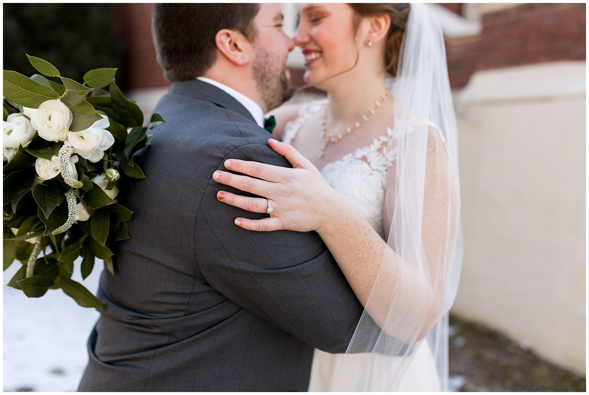 groom pulls bride close with The Flower Boys bouquet wrapped around his back