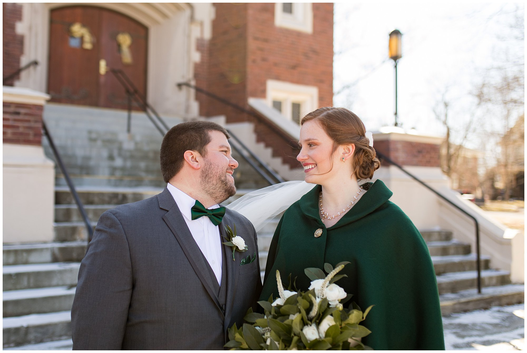 bride and groom hold hands outside of Irvington United Methodist Church in downtown Indianapolis