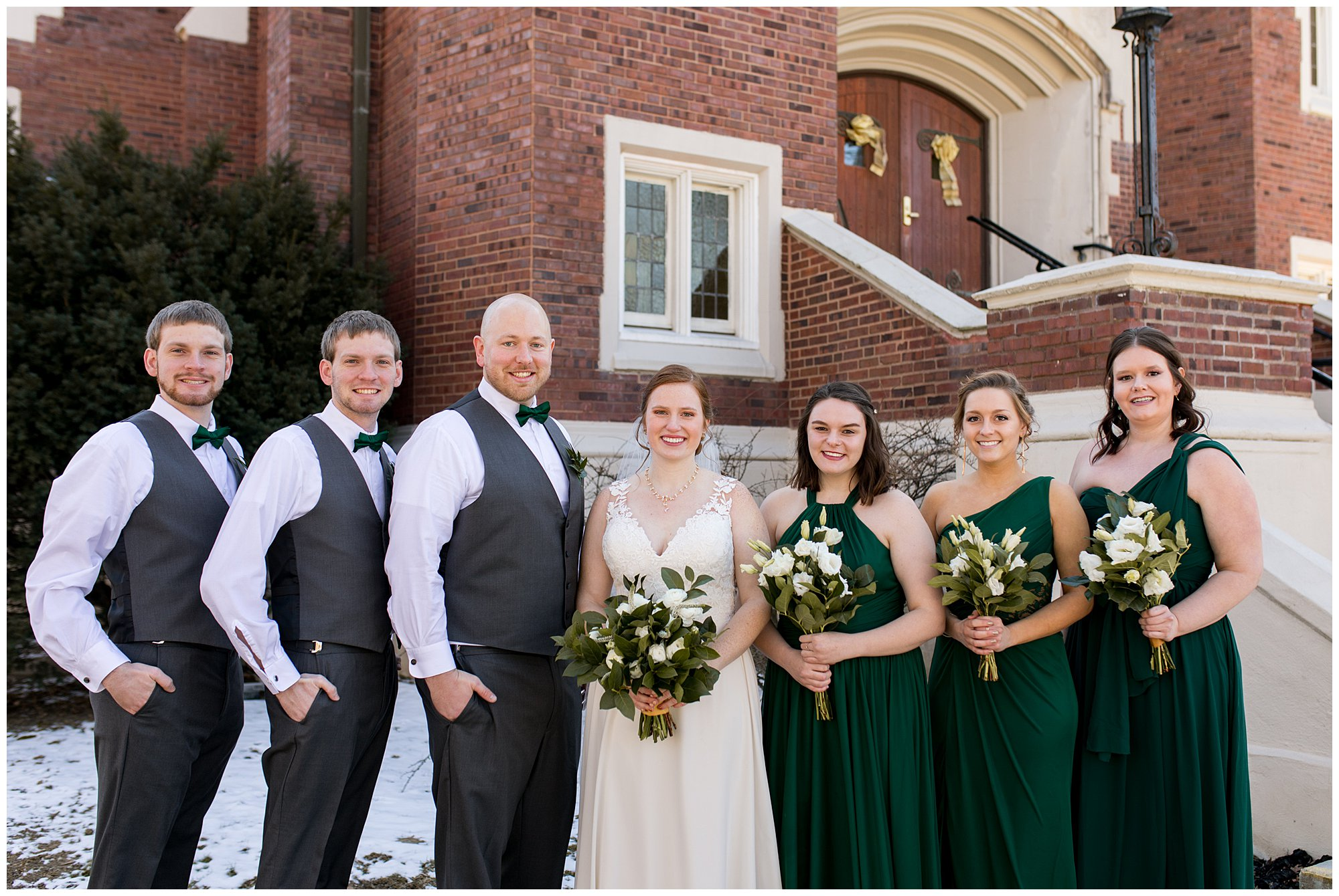 bride with bridesmaids outside downtown Indianapolis church before wedding ceremony