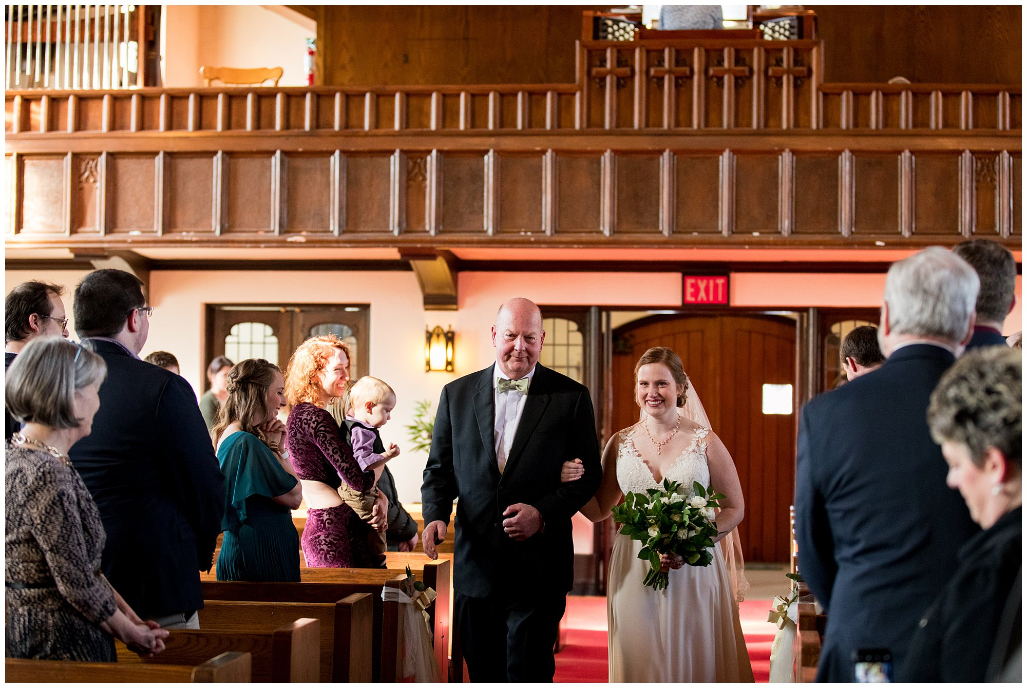 bride and her father walk down church aisle during Indianapolis wedding ceremony