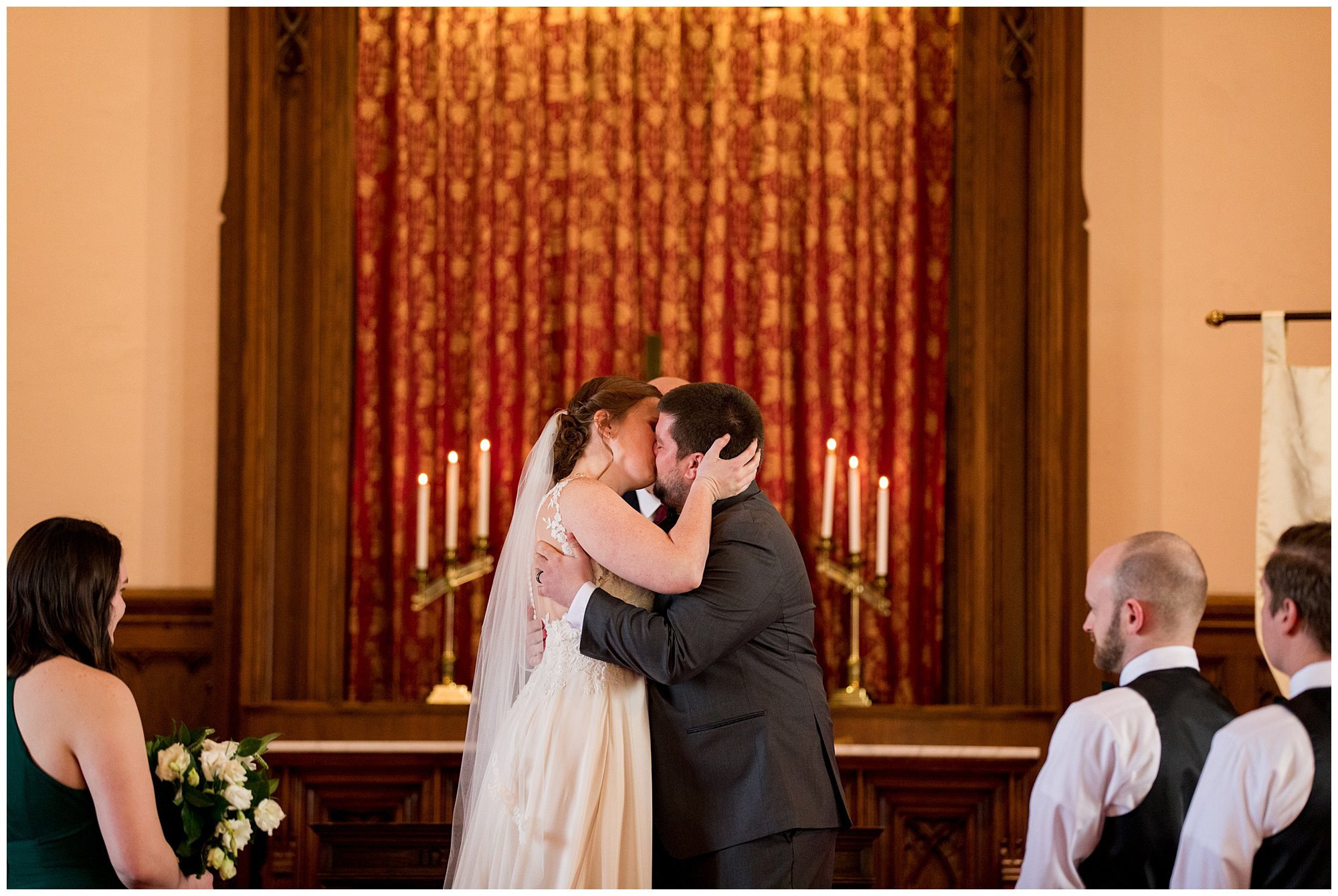 bride and groom first kiss at Indianapolis wedding ceremony