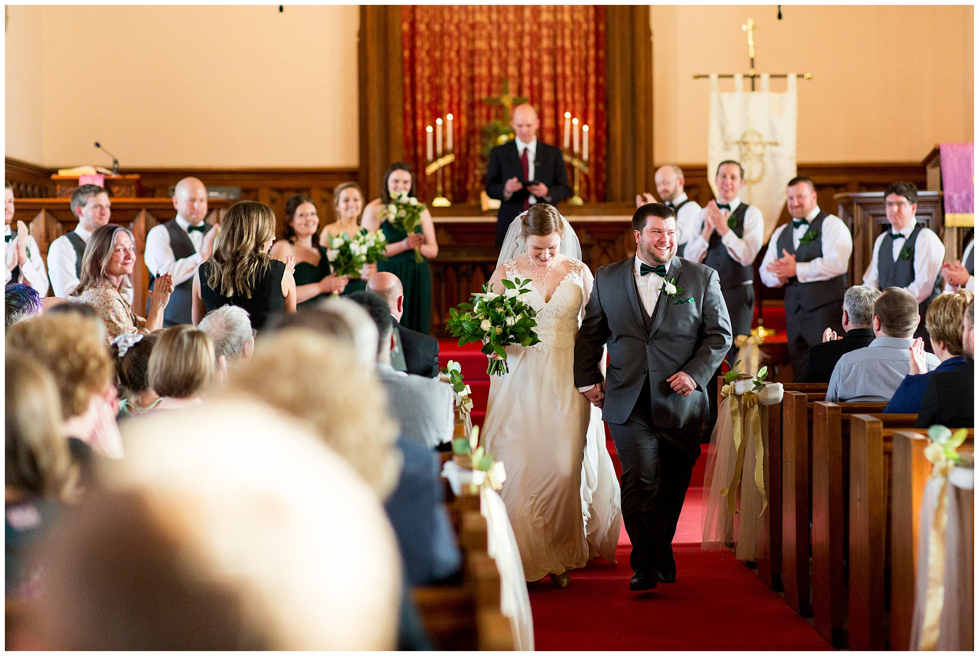 bride and groom exit Irvington United Methodist Church after wedding ceremony in Indianapolis