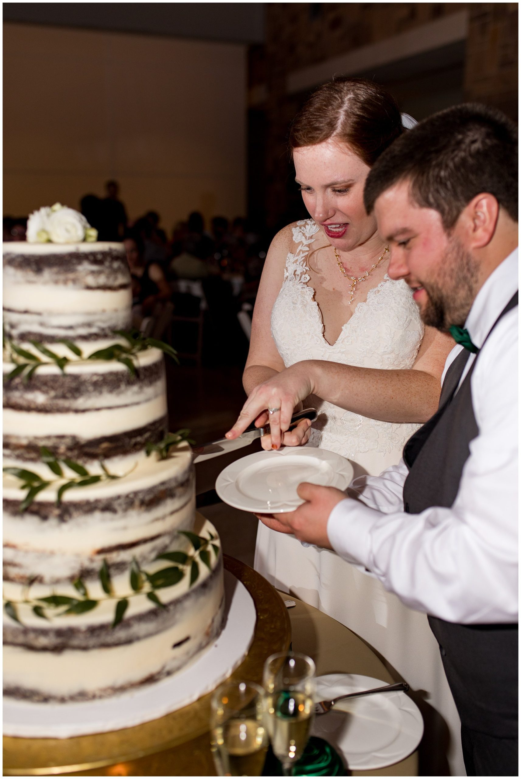bride and groom cut Kahn's Catering wedding cake together