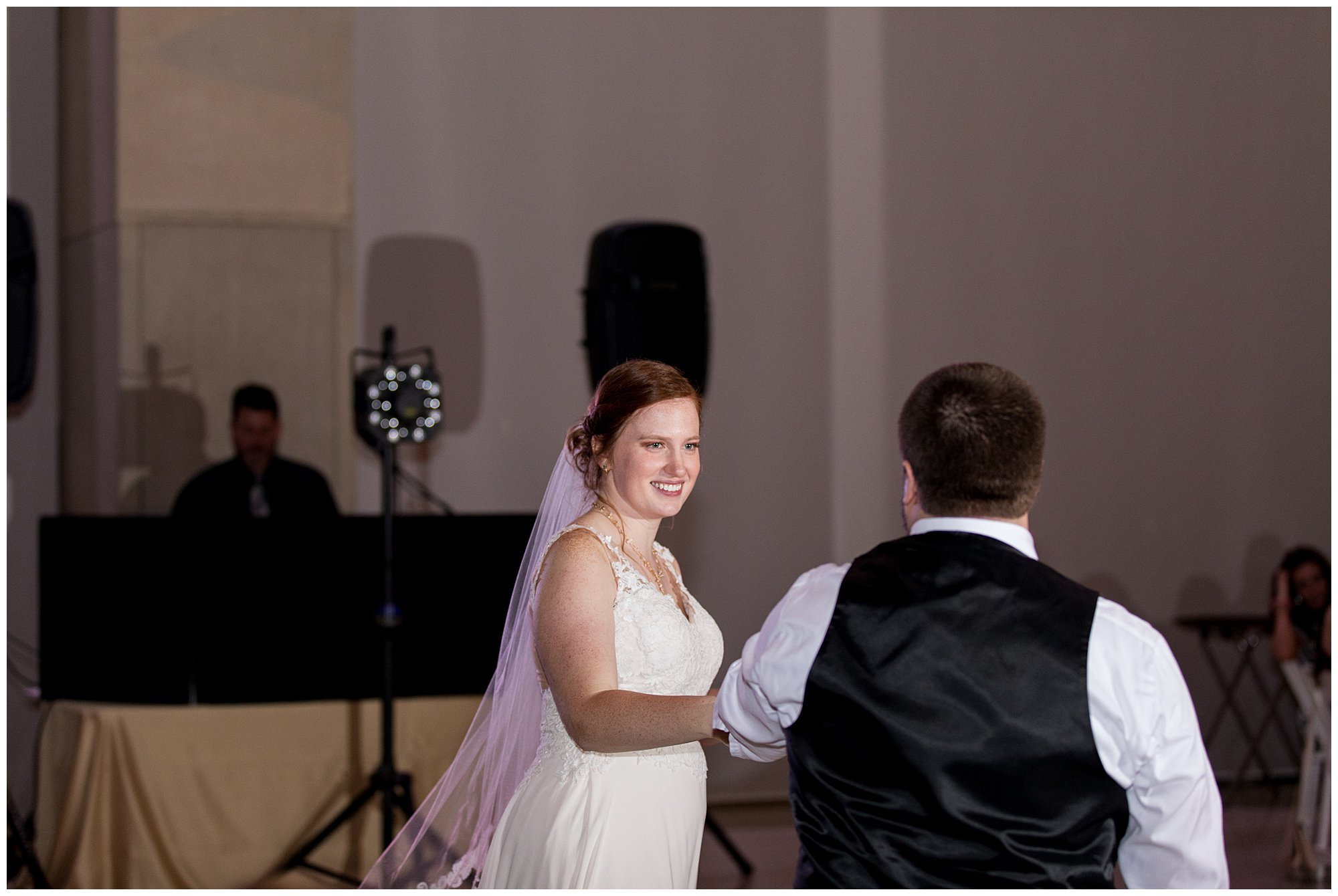 bride and groom have first dance during Indianapolis wedding reception