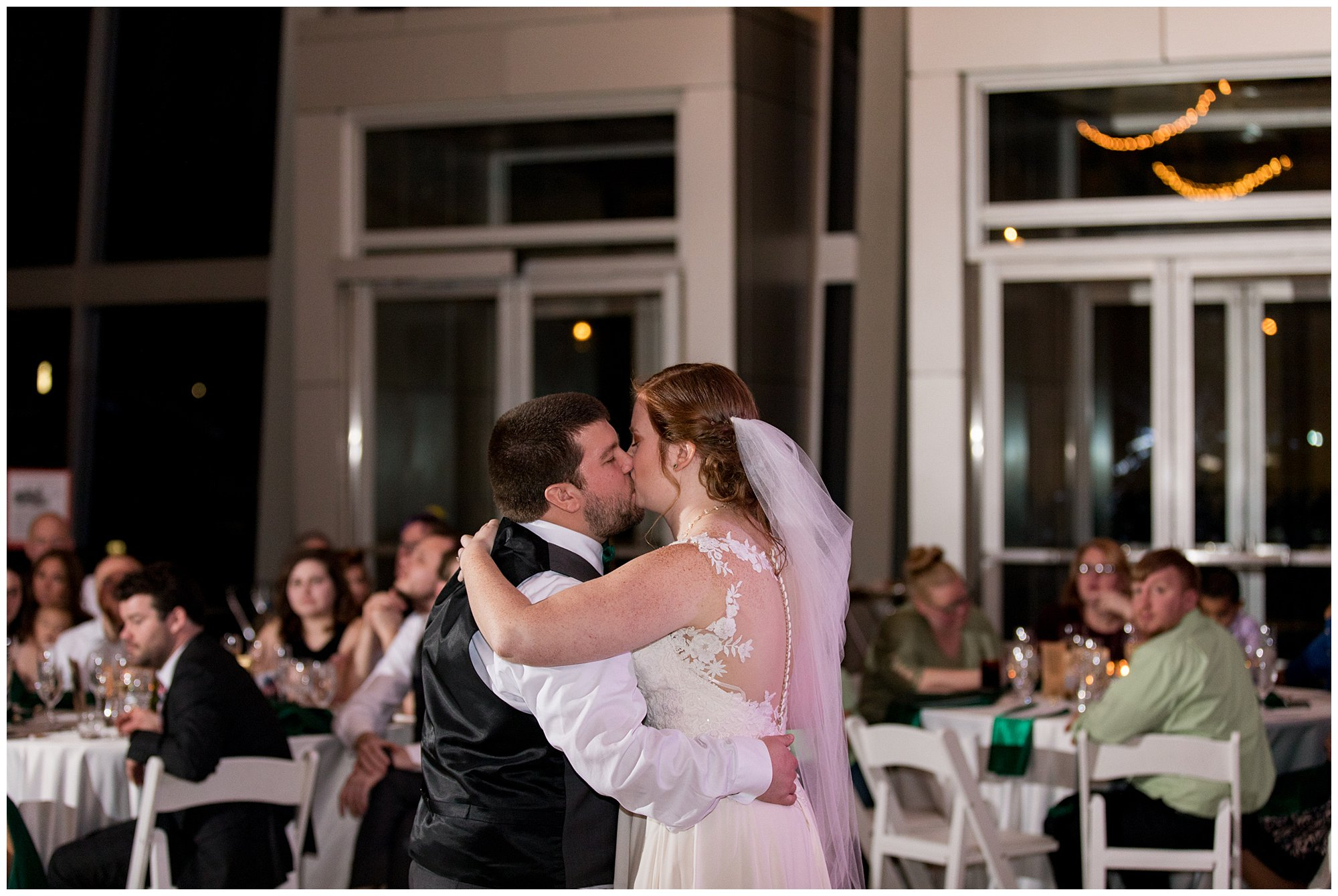 bride and groom kiss during first dance at Indiana State Museum