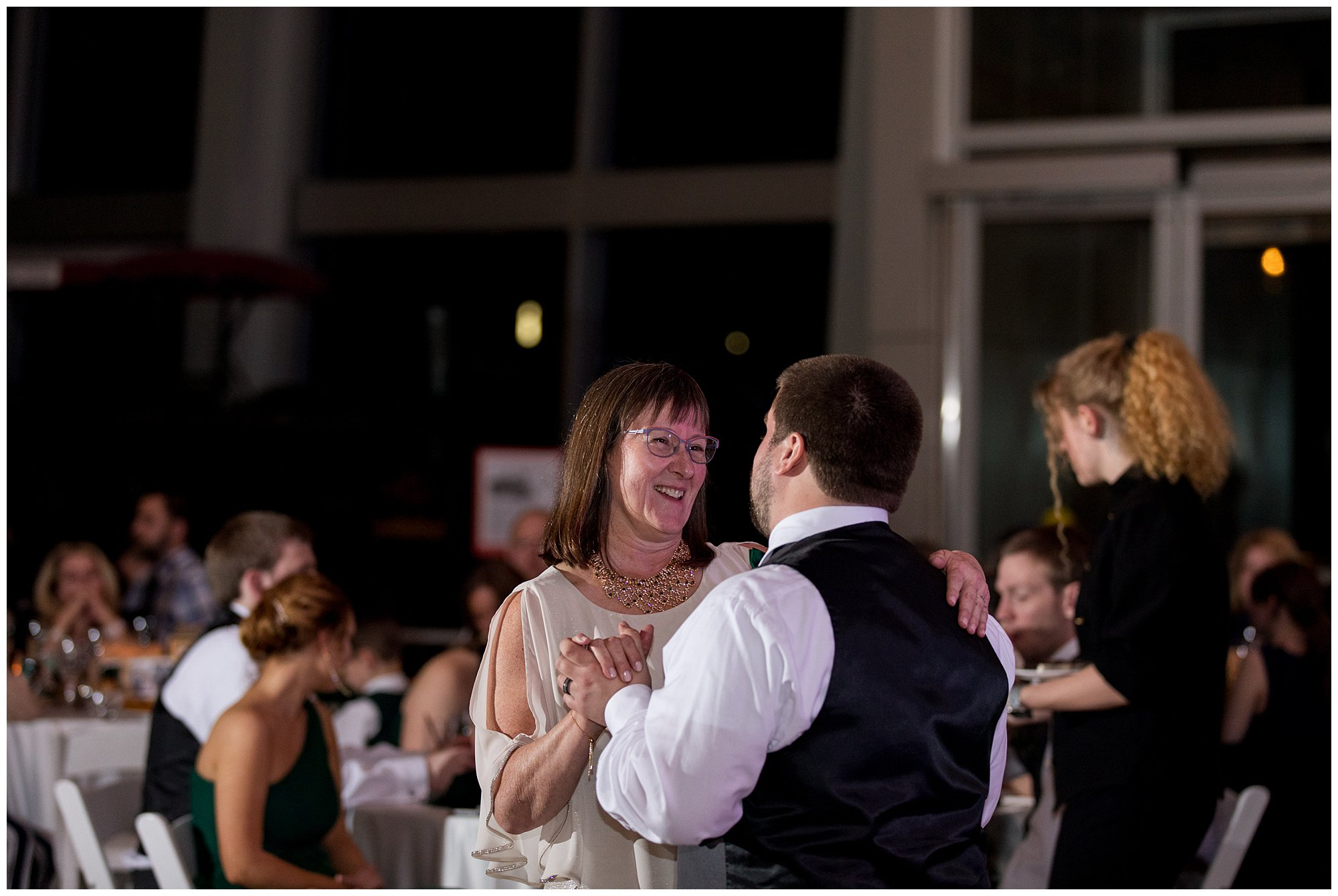 groom and mother dance during Indianapolis wedding reception