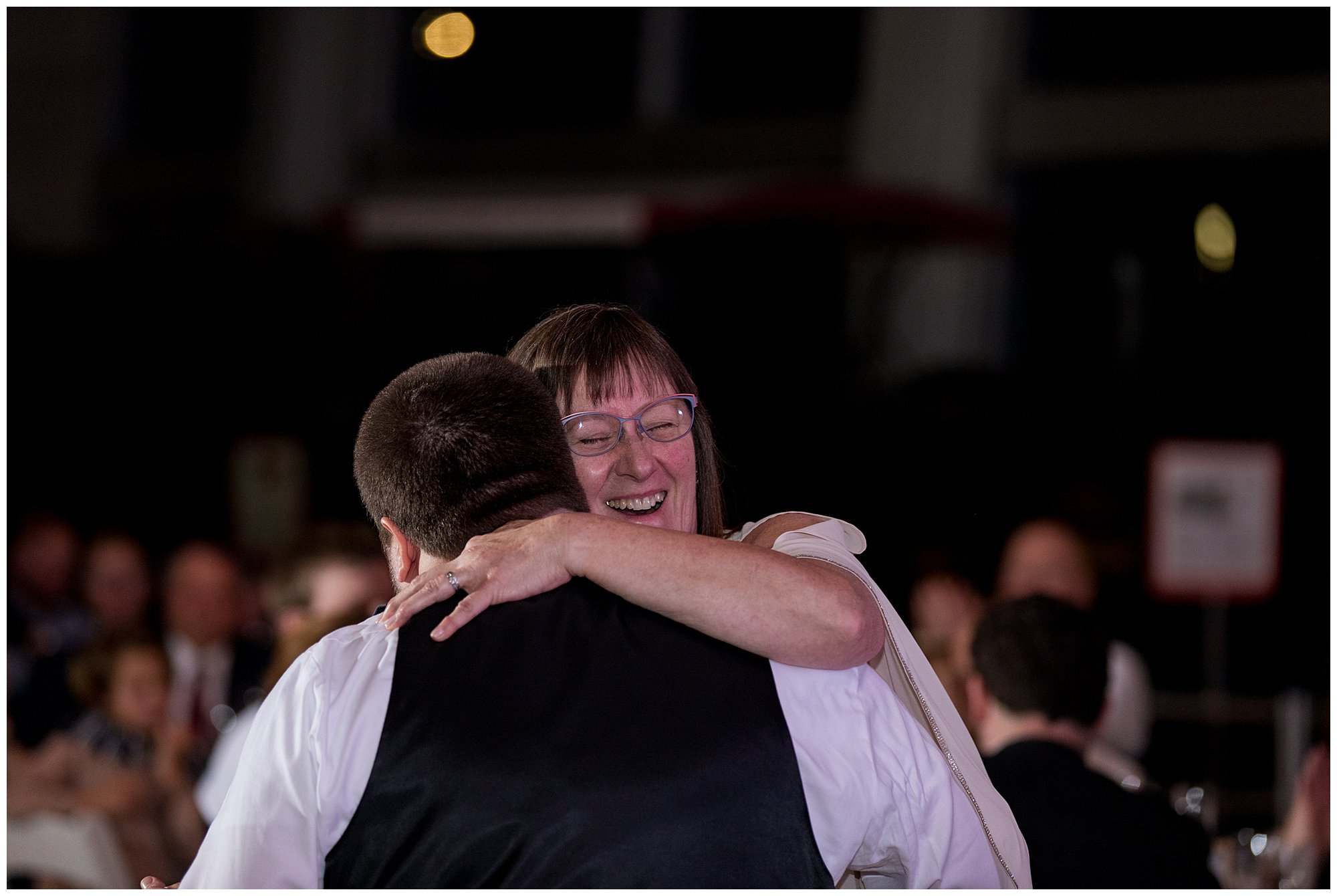 groom and mother dance during wedding reception at Indiana State Museum