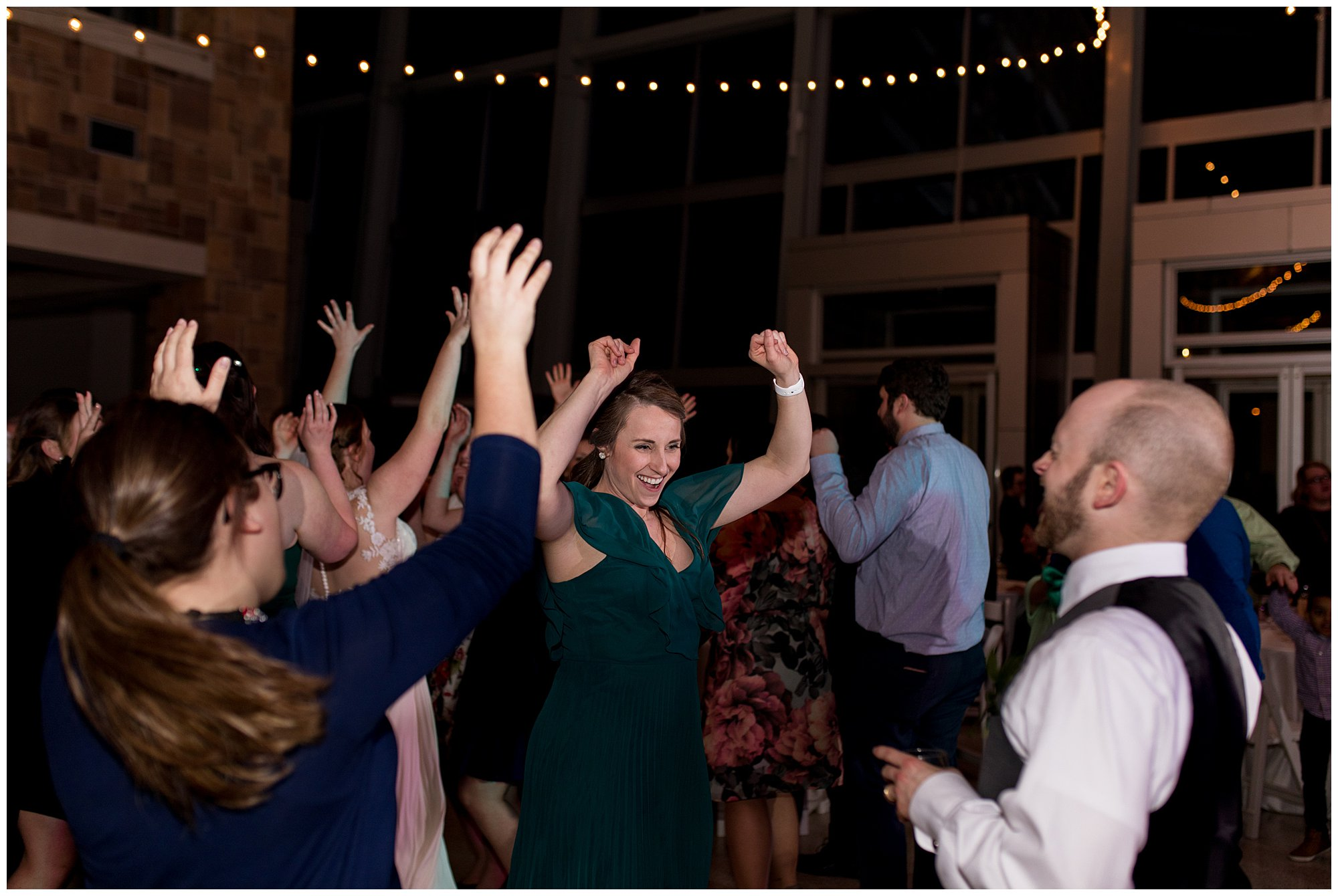 best man and wife dance during wedding reception in downtown Indianapolis