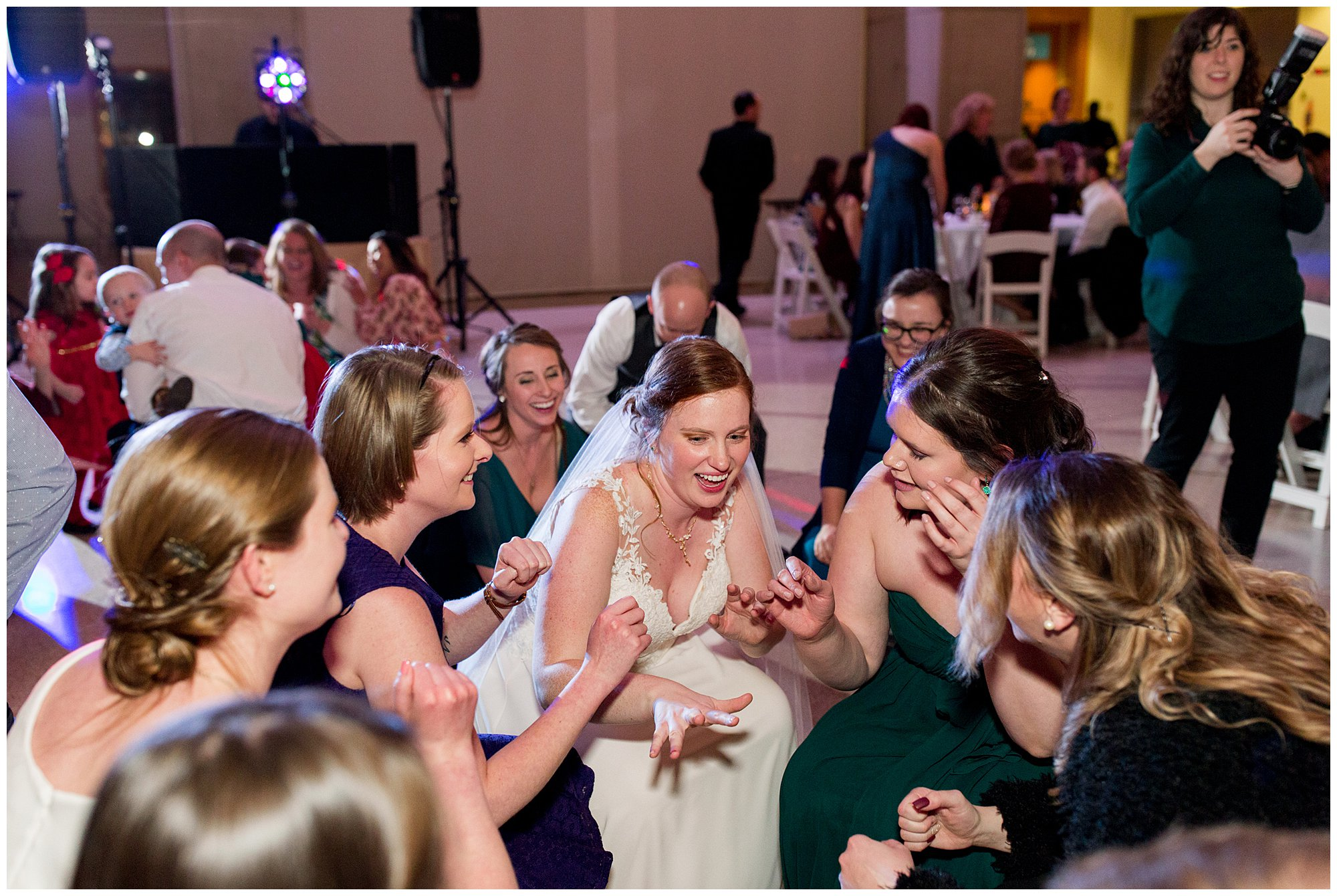 bride dances on dance floor surrounded by guests at Indiana State Museum