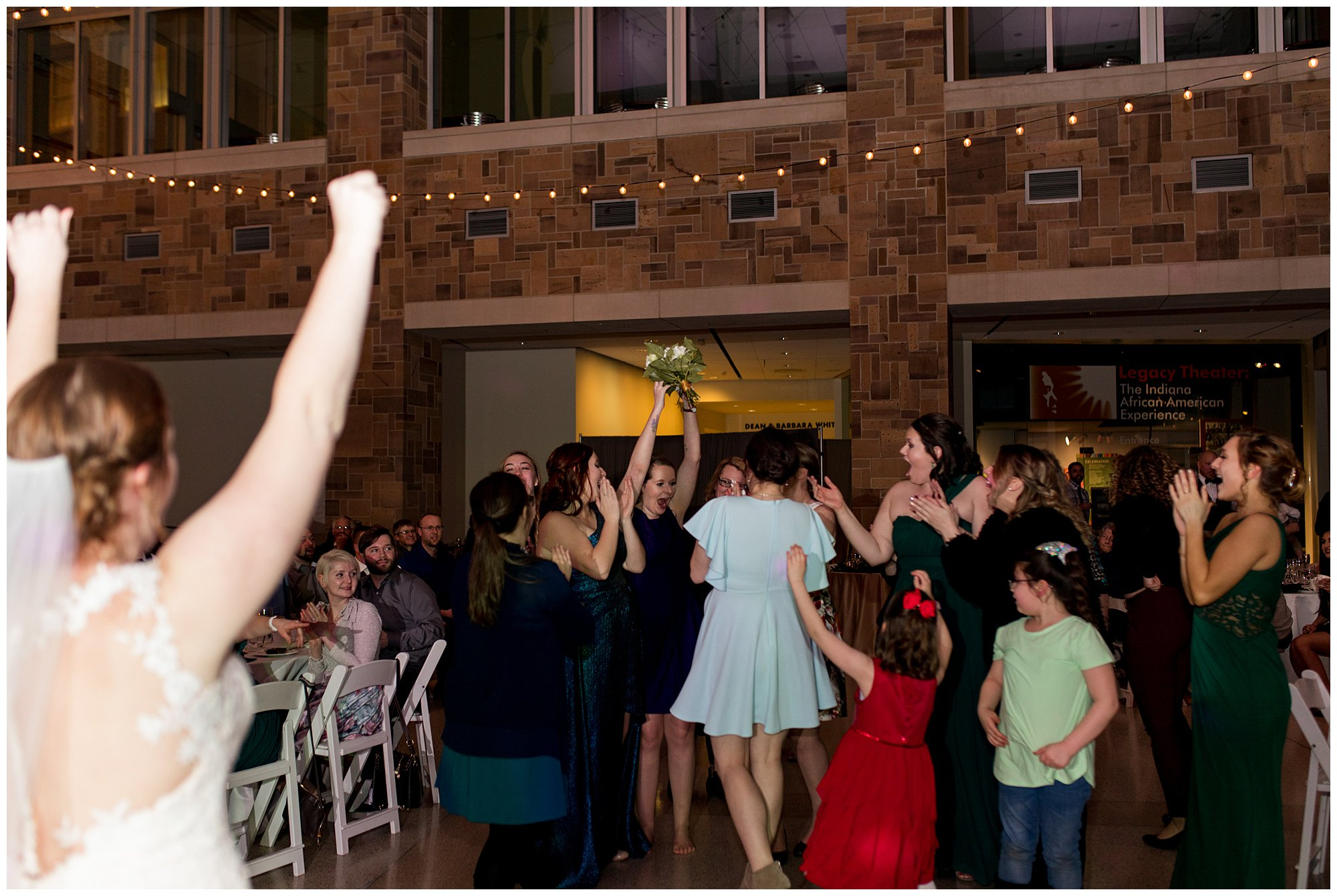 guest catches bouquet tossed by bride at Indiana State Museum