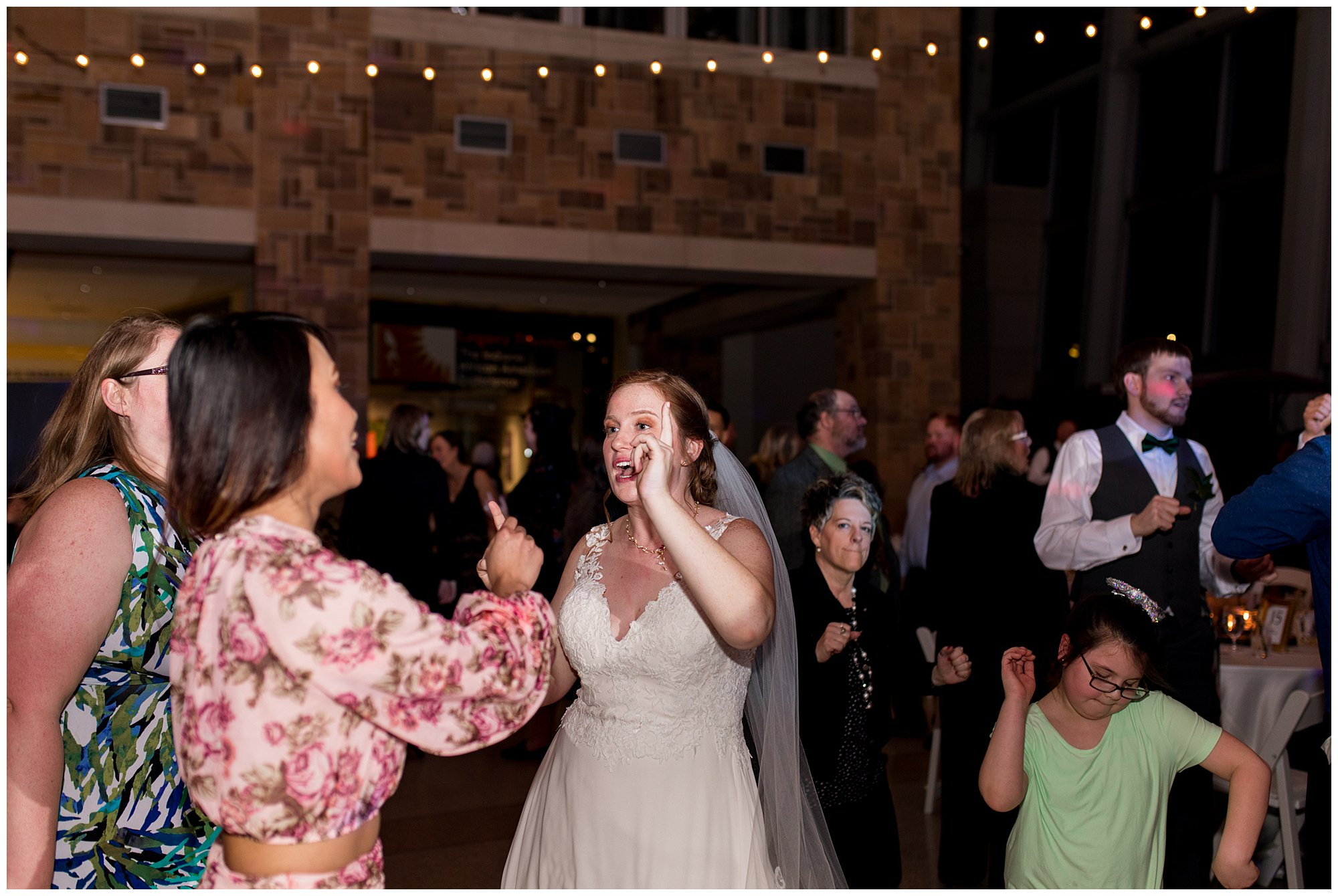 bride dances at wedding reception in downtown Indianapolis with guests