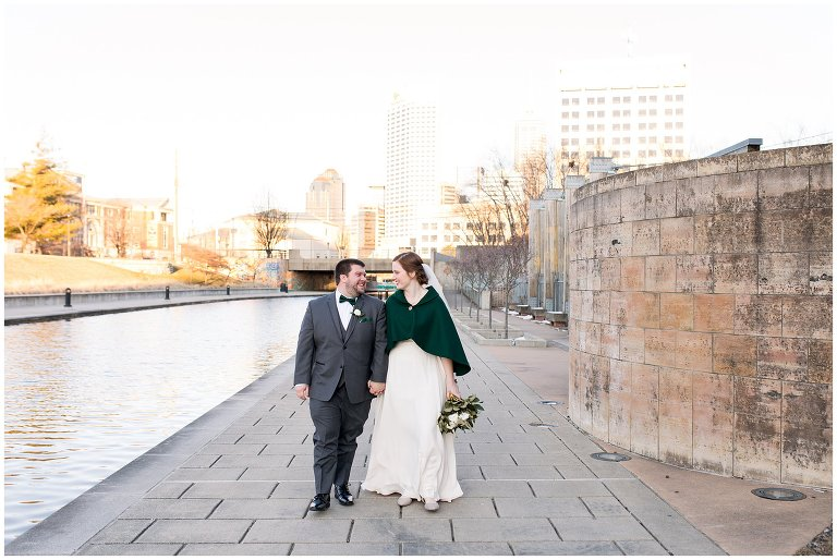 downtown Indianapolis bride and groom walking along White River Canal