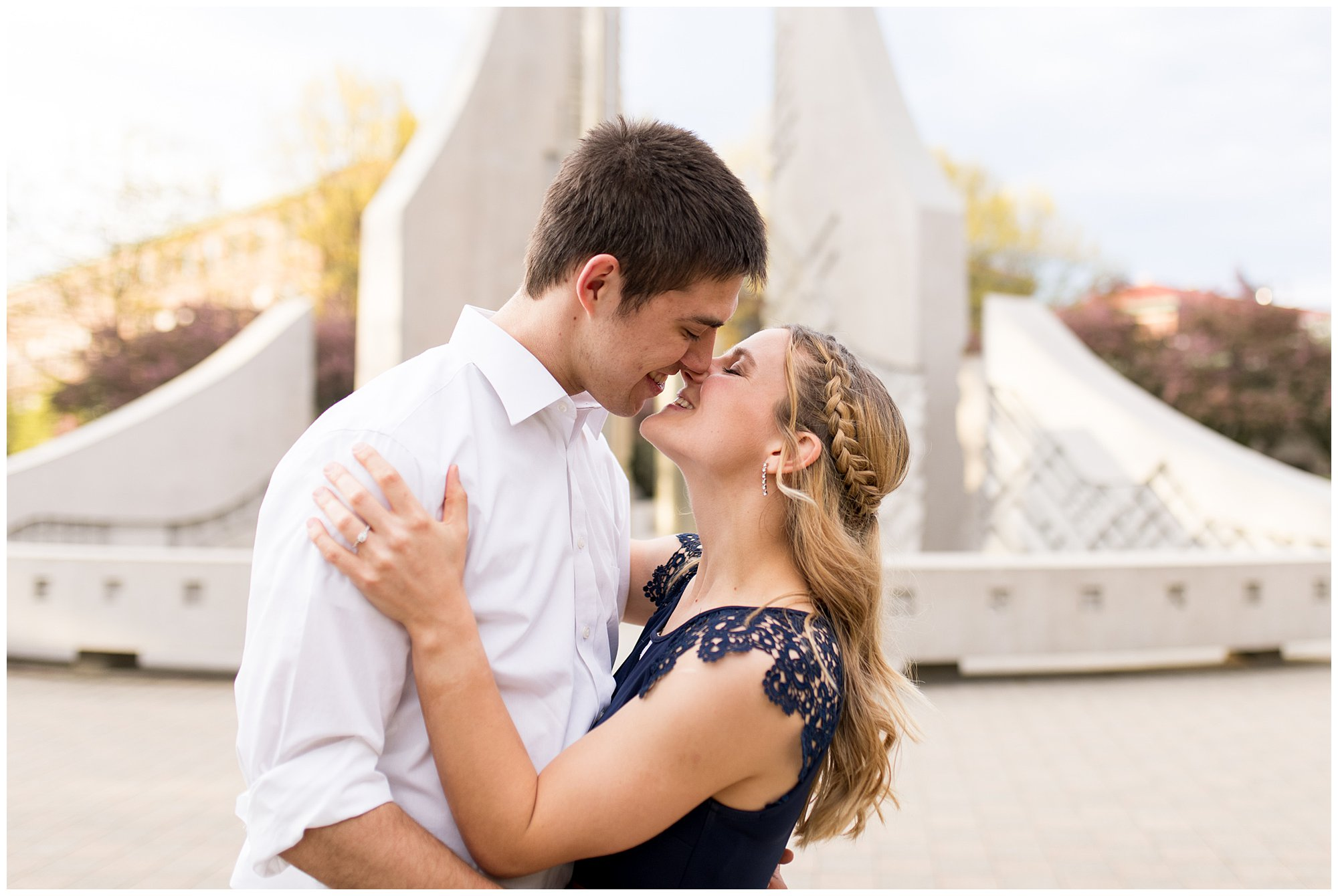 bride and groom kiss in front of engineering fountain on Purdue's campus