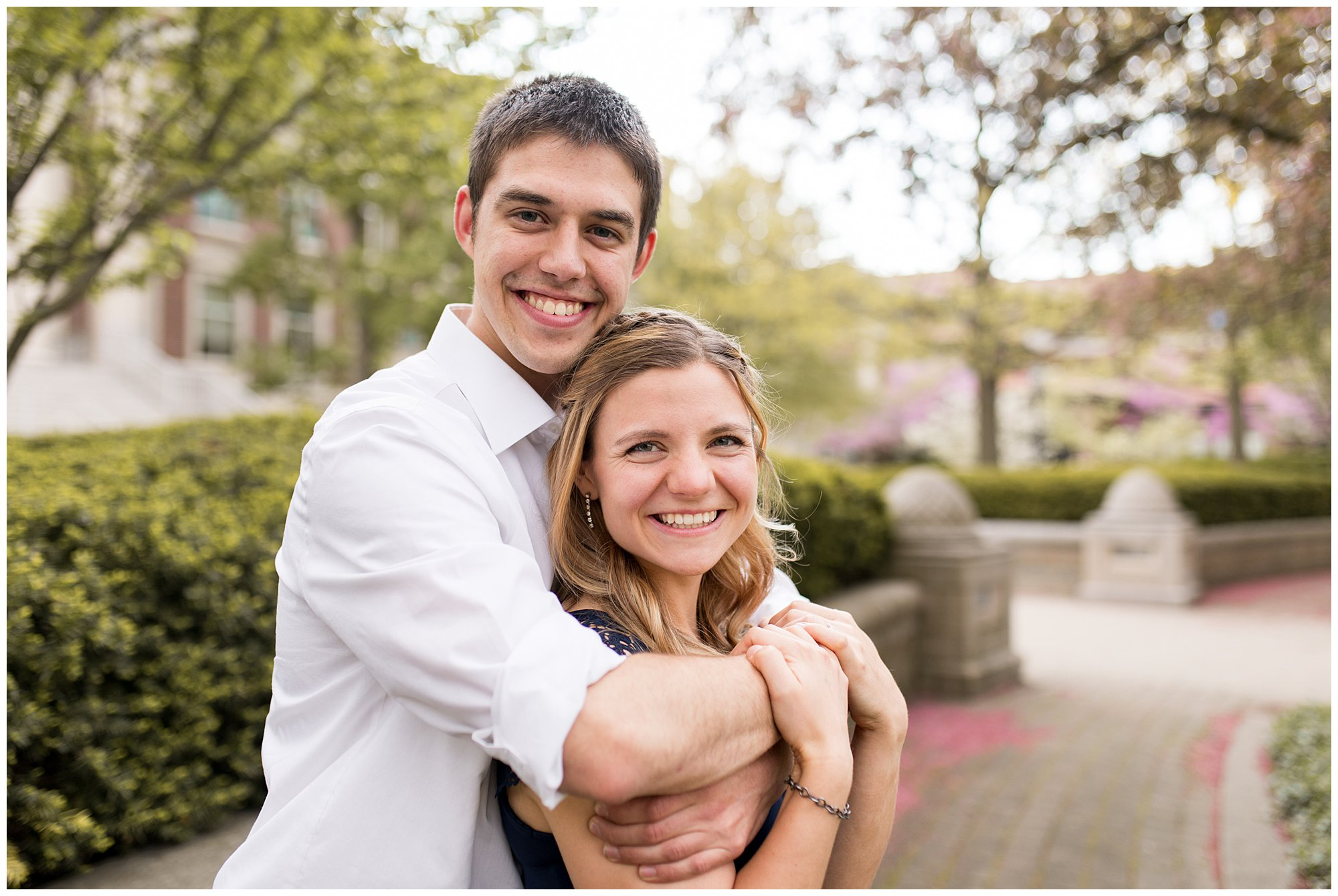 groom wraps arms around bride during Purdue engagement session