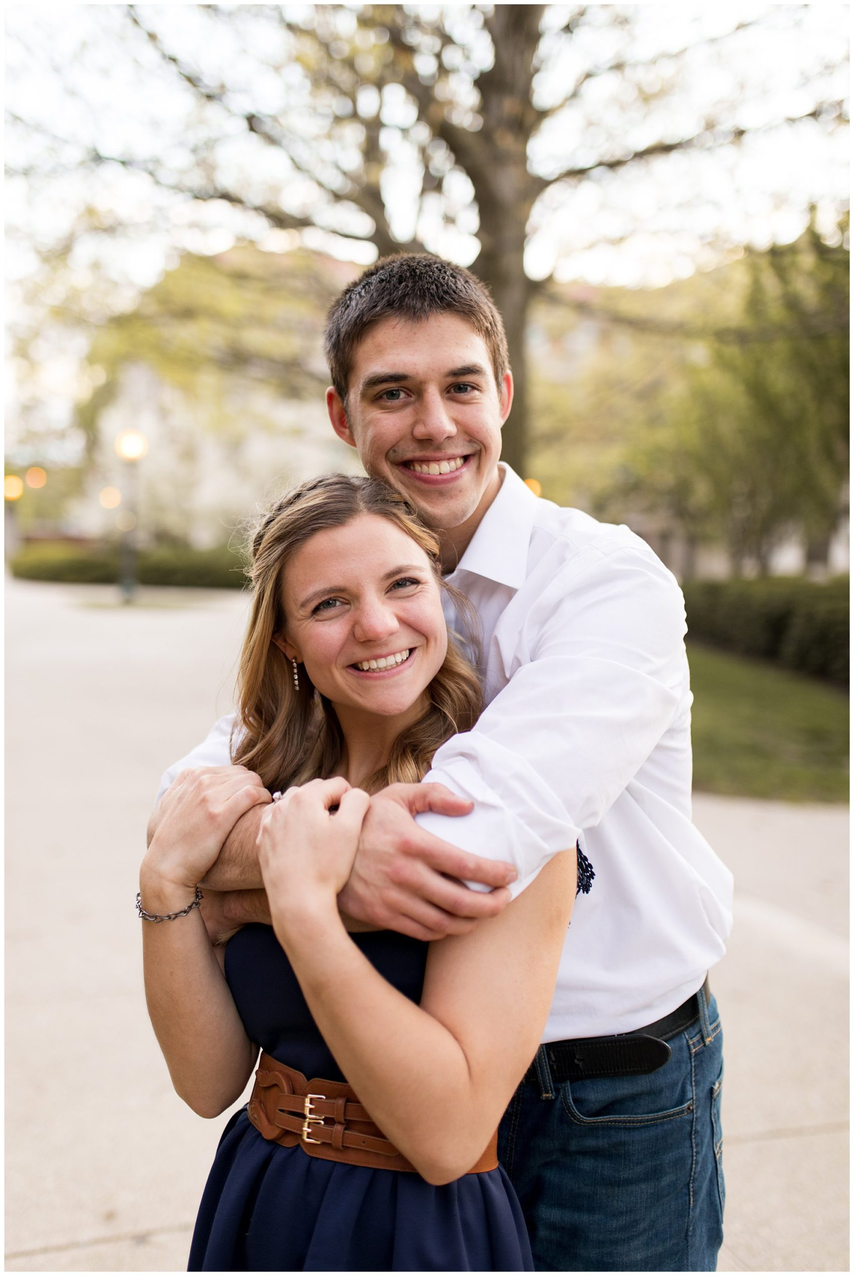 groom wraps arms around bride during Lafayette, Indiana engagement session