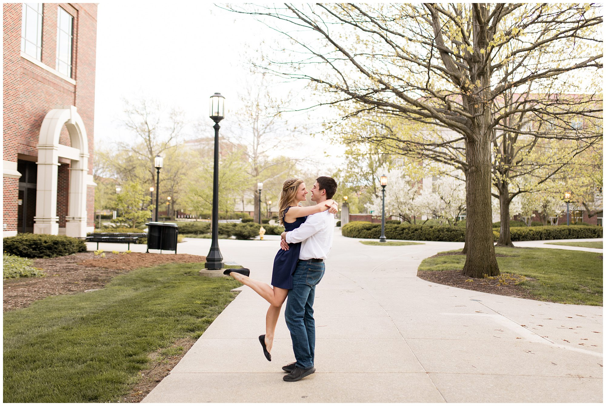 groom lifts bride during Lafayette Indiana engagement session
