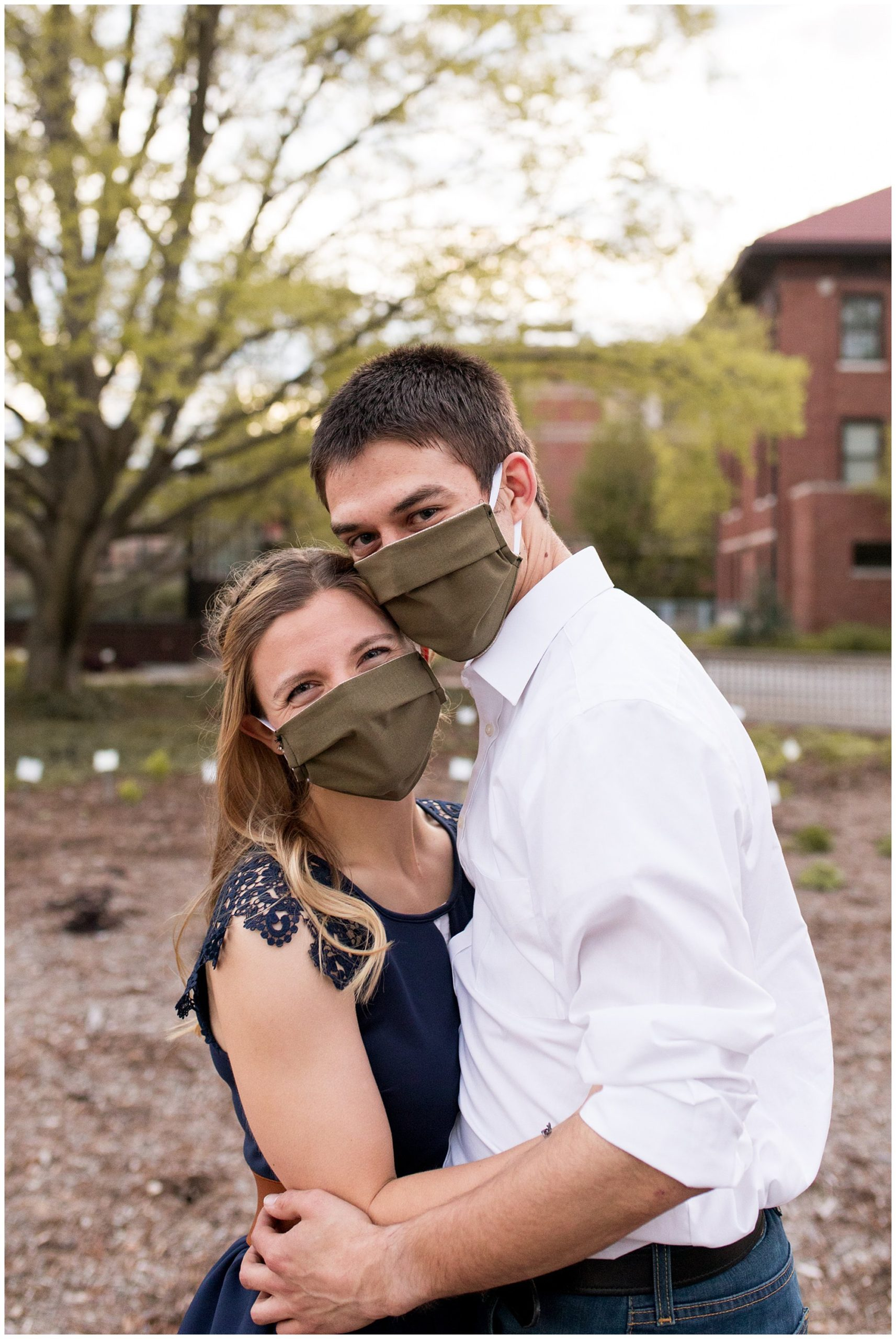bride and groom face masks during COVID-19 engagement session