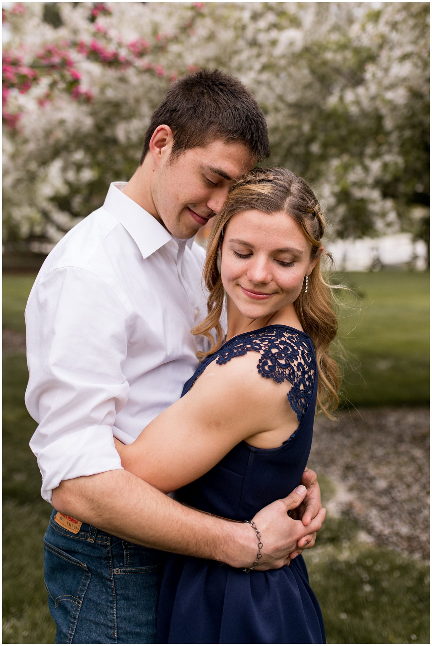 bride looks over shoulder during engagement session on Purdue University's campus