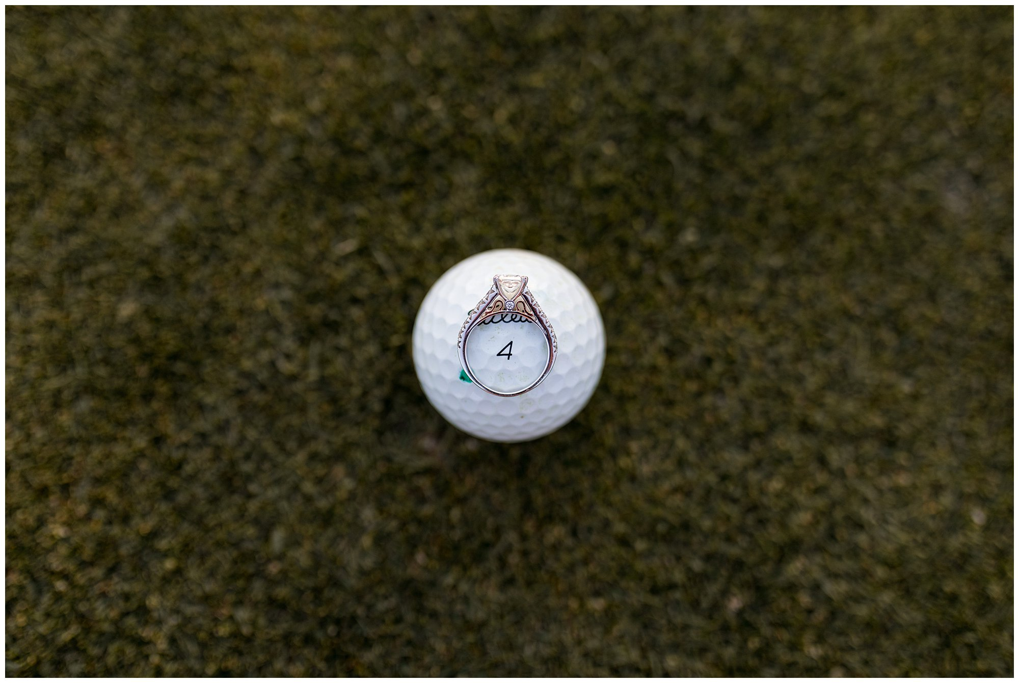 engagement ring on golf ball