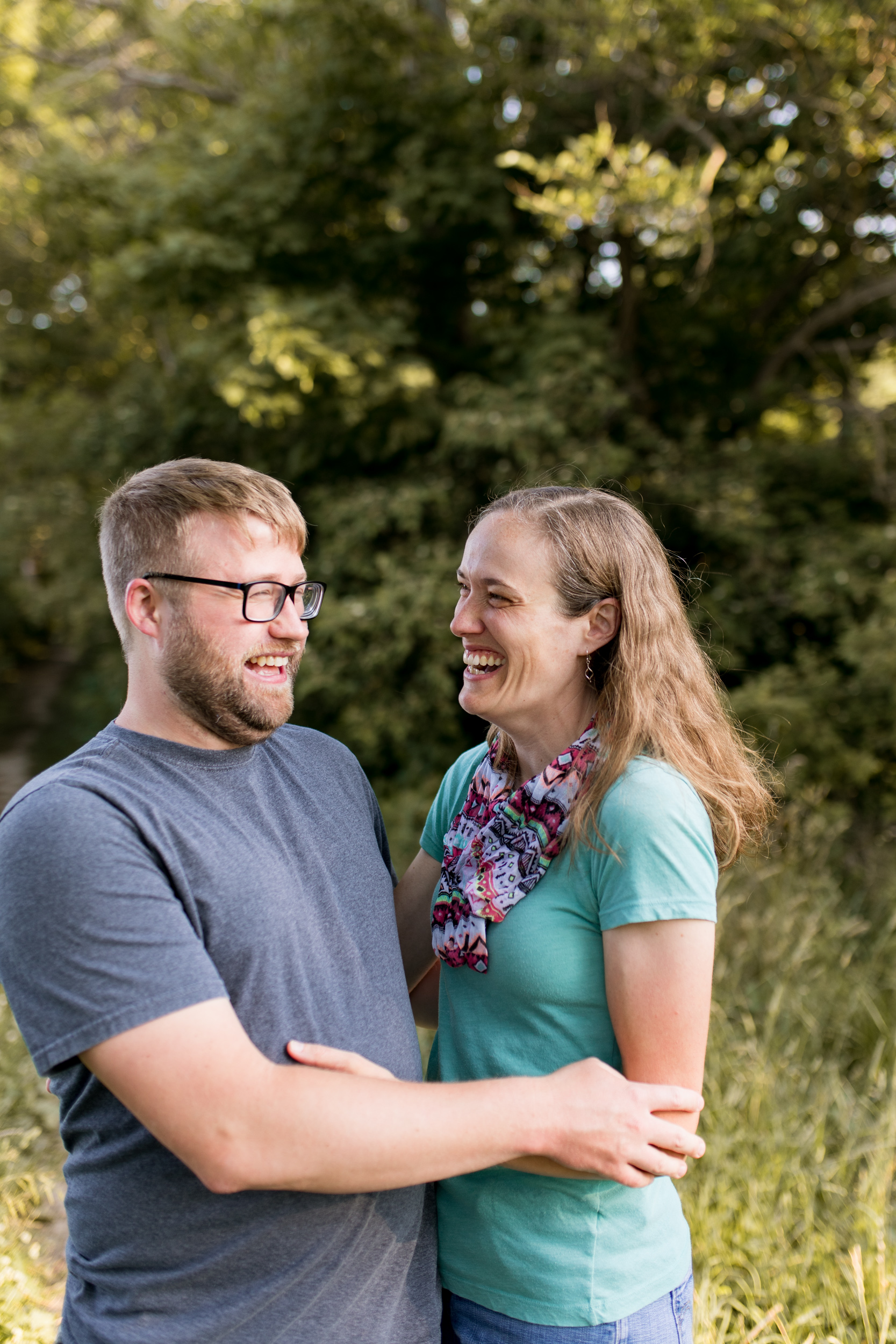 mom and dad laugh together during Kokomo Indiana family session