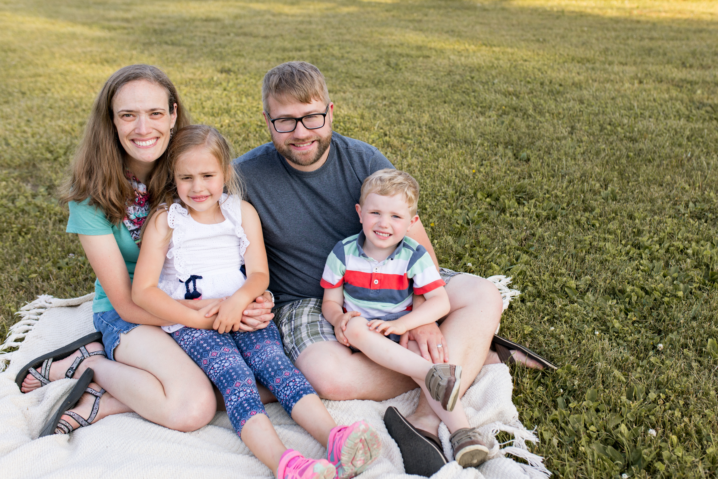 family snuggles on blanket during family session in Kokomo Indiana
