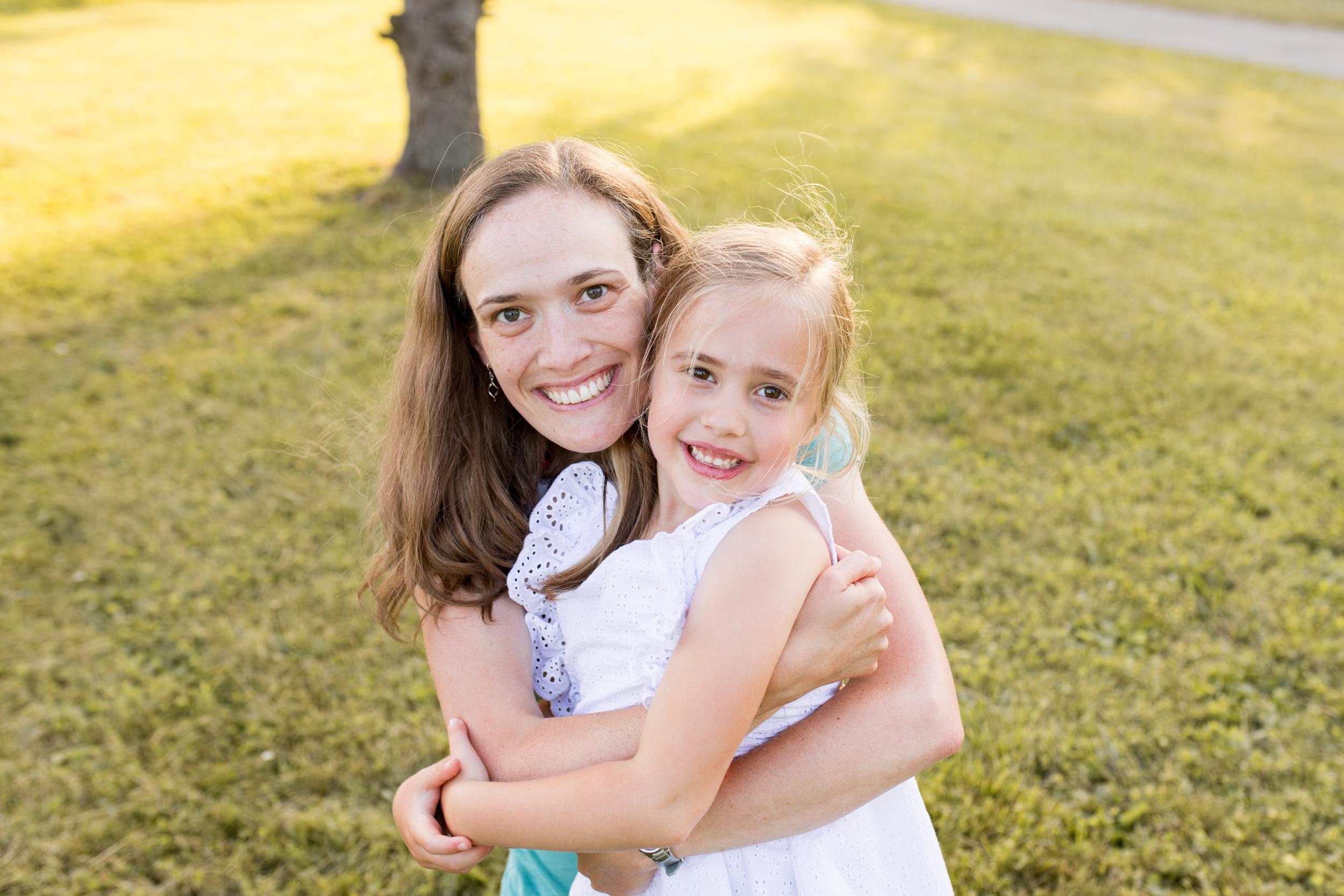 mom wraps arms around daughter