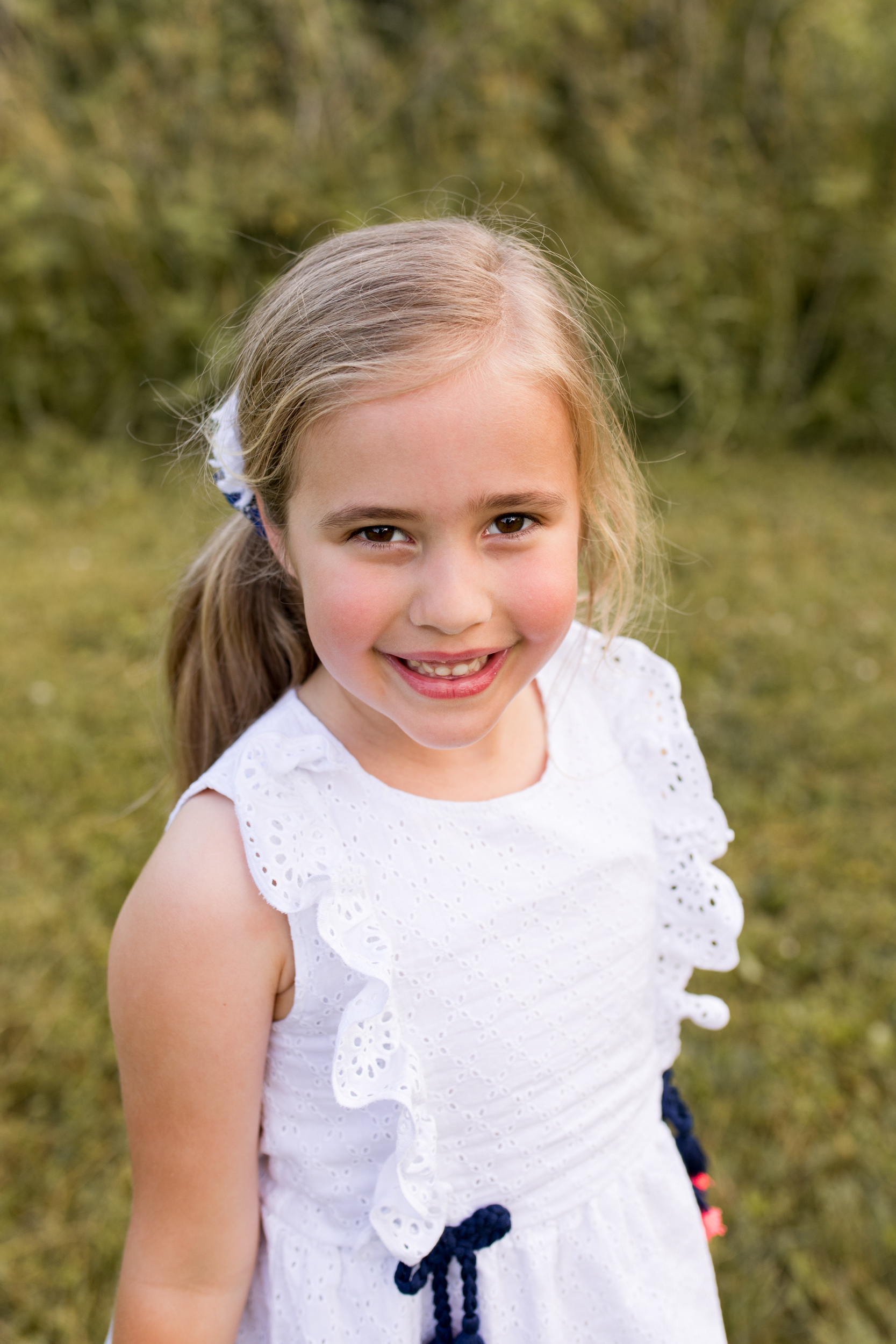 young girl poses for photo during Kokomo Indiana family session