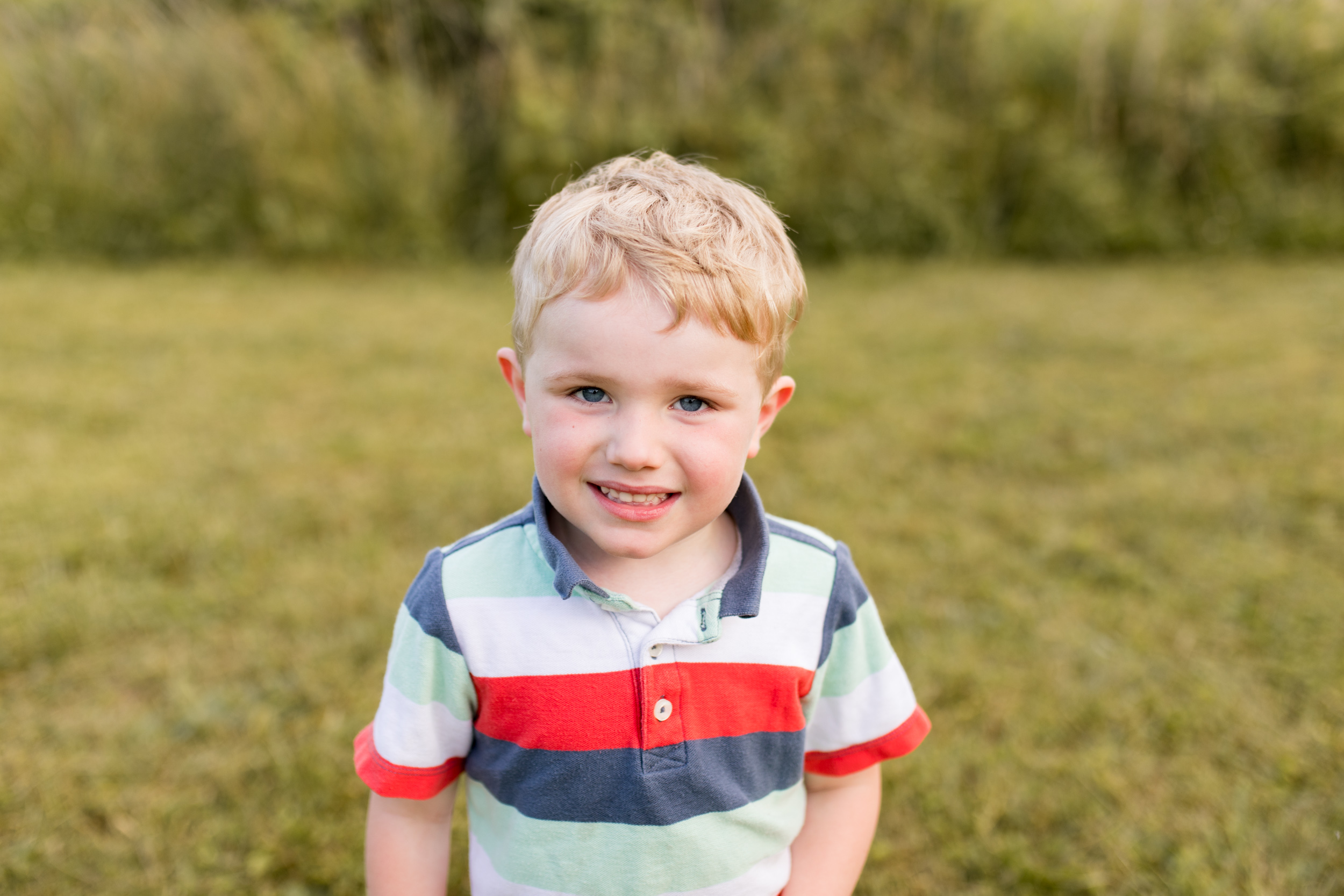 young boy poses for photo during Kokomo Indiana family session