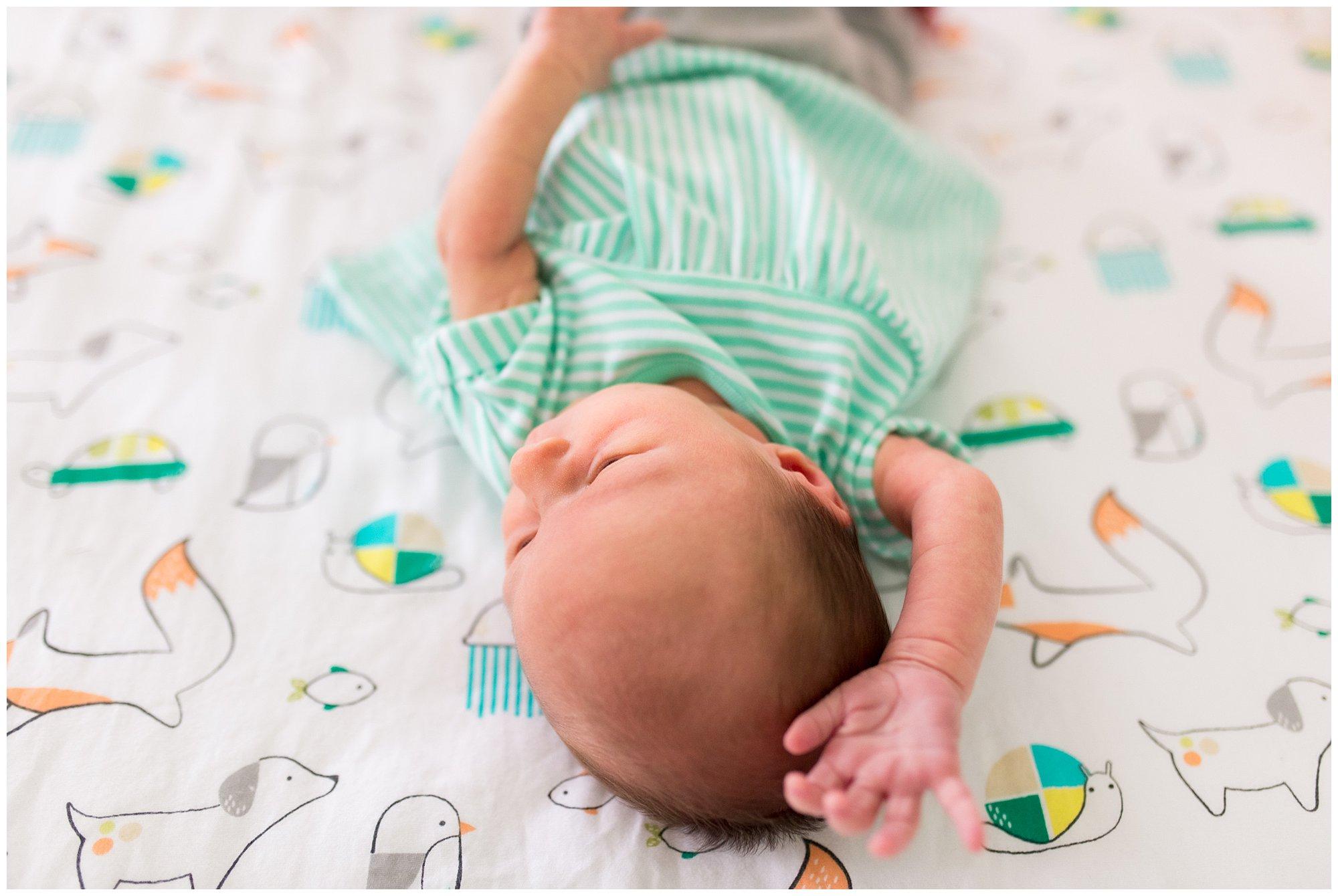 newborn baby in mint green dress in Muncie Indiana