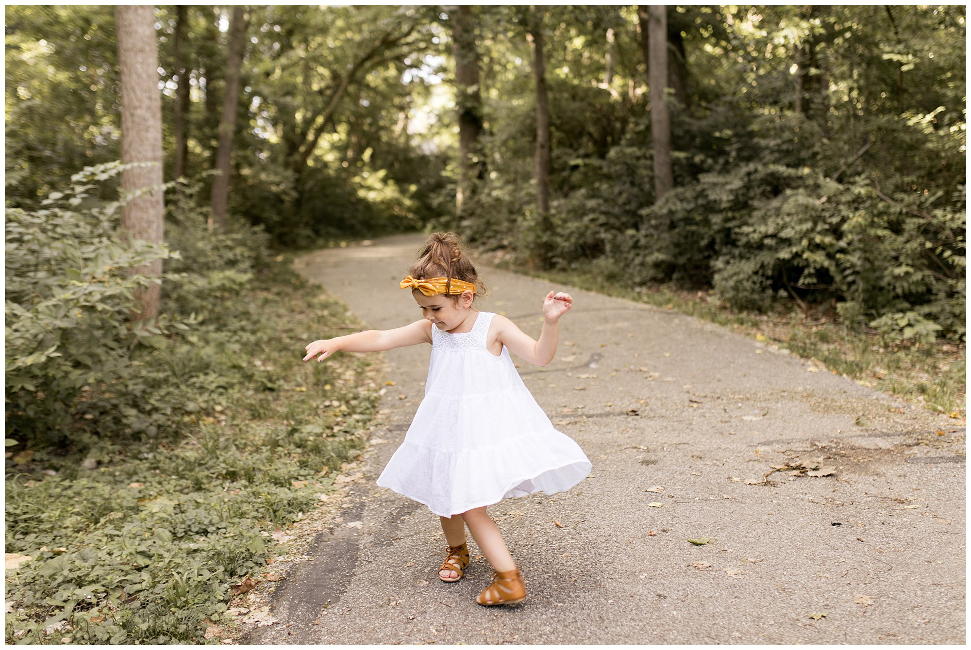 little girl during Northwest Park Annex family session in Greenwood, Indiana