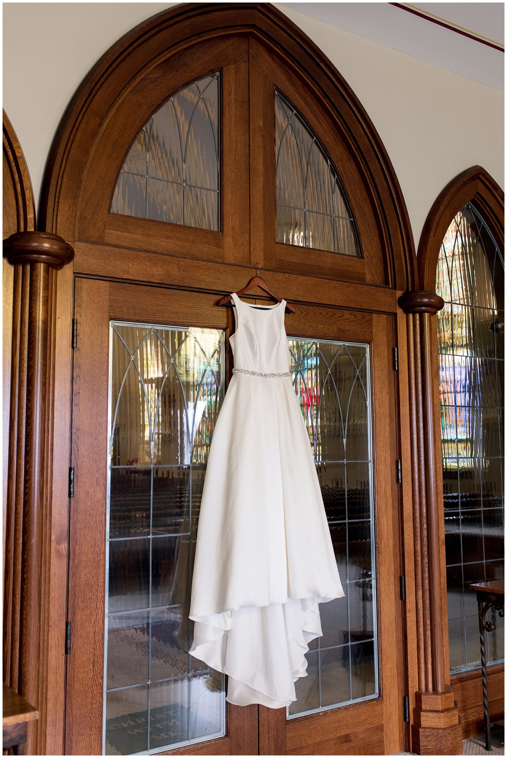 bride's dress hanging from doors to sanctuary at St. Patrick Church in Kokomo Indiana